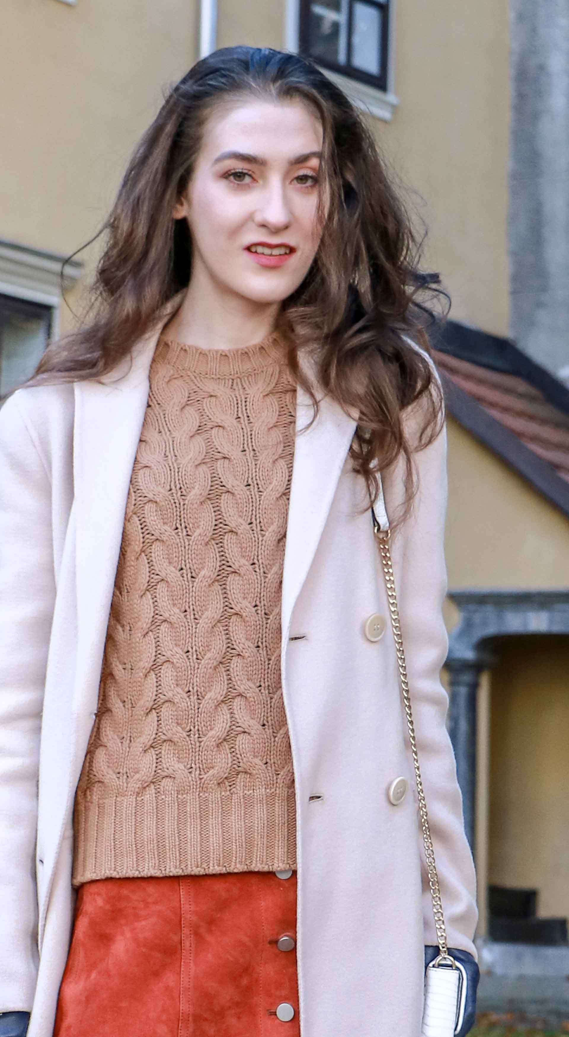 Beautiful Slovenian Fashion Blogger Veronika Lipar of Brunette from Wall wearing Max Mara camel cable knit sweater, front button brown suede skirt