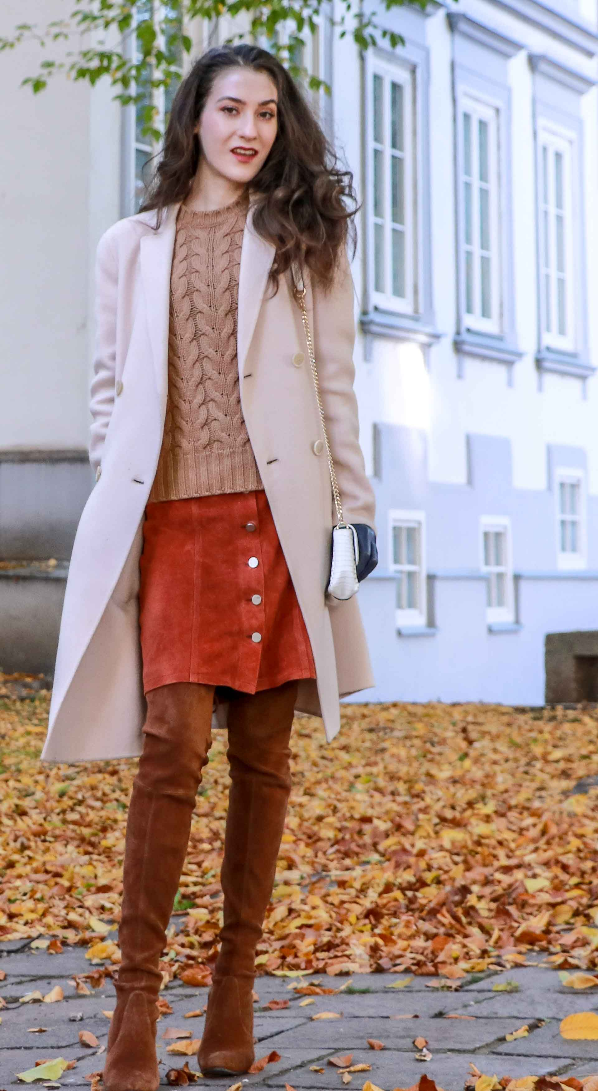 Beautiful Slovenian Fashion Blogger Veronika Lipar of Brunette from Wall wearing Max Mara camel cable knit sweater, front button brown suede skirt, Stuart Weitzman brown over the knee boots, Max Mara coat in fall