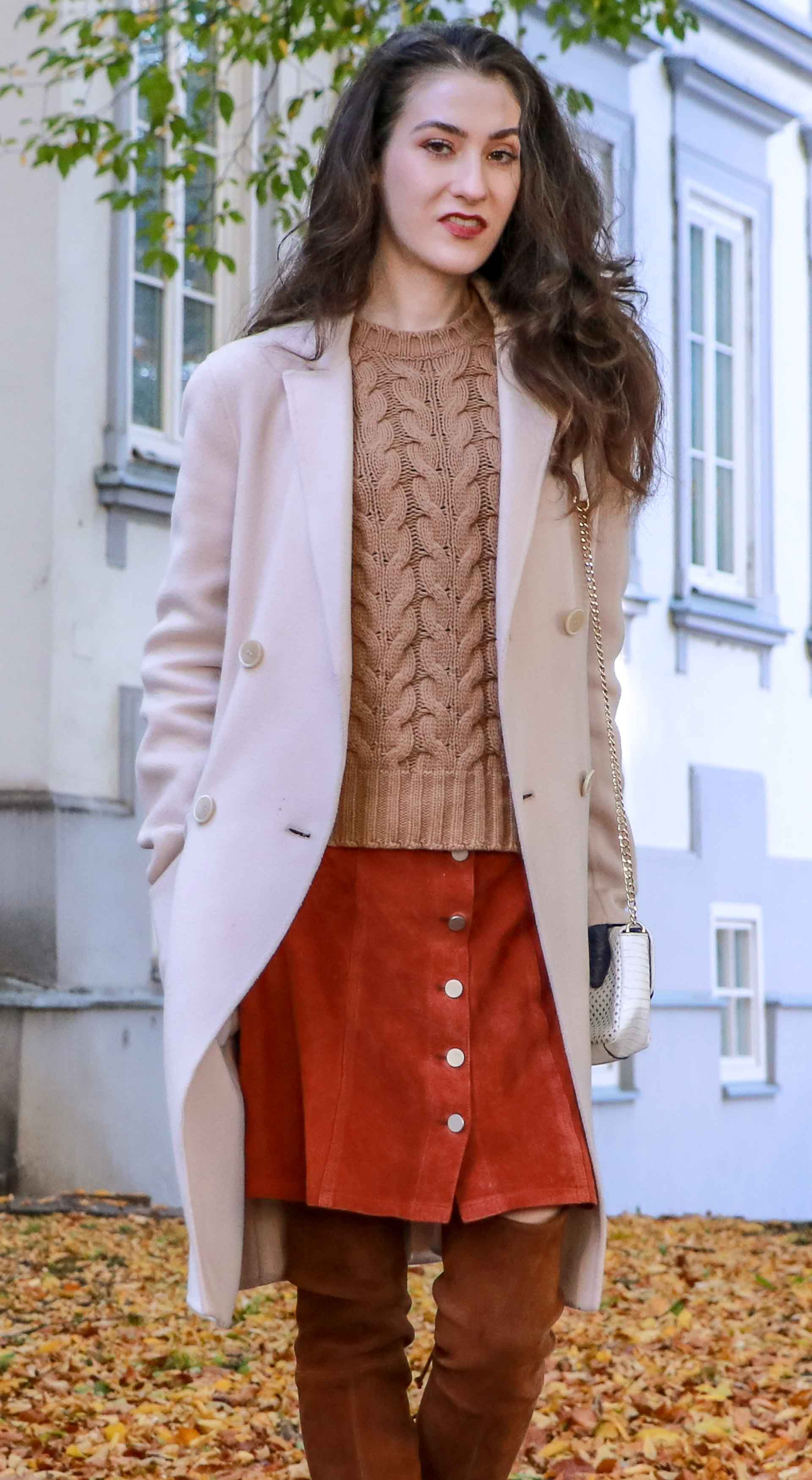 Beautiful Slovenian Fashion Blogger Veronika Lipar of Brunette from Wall dressed in Max Mara camel cable knit sweater, front button brown suede skirt, Stuart Weitzman brown over the knee boots, Max Mara coat in fall