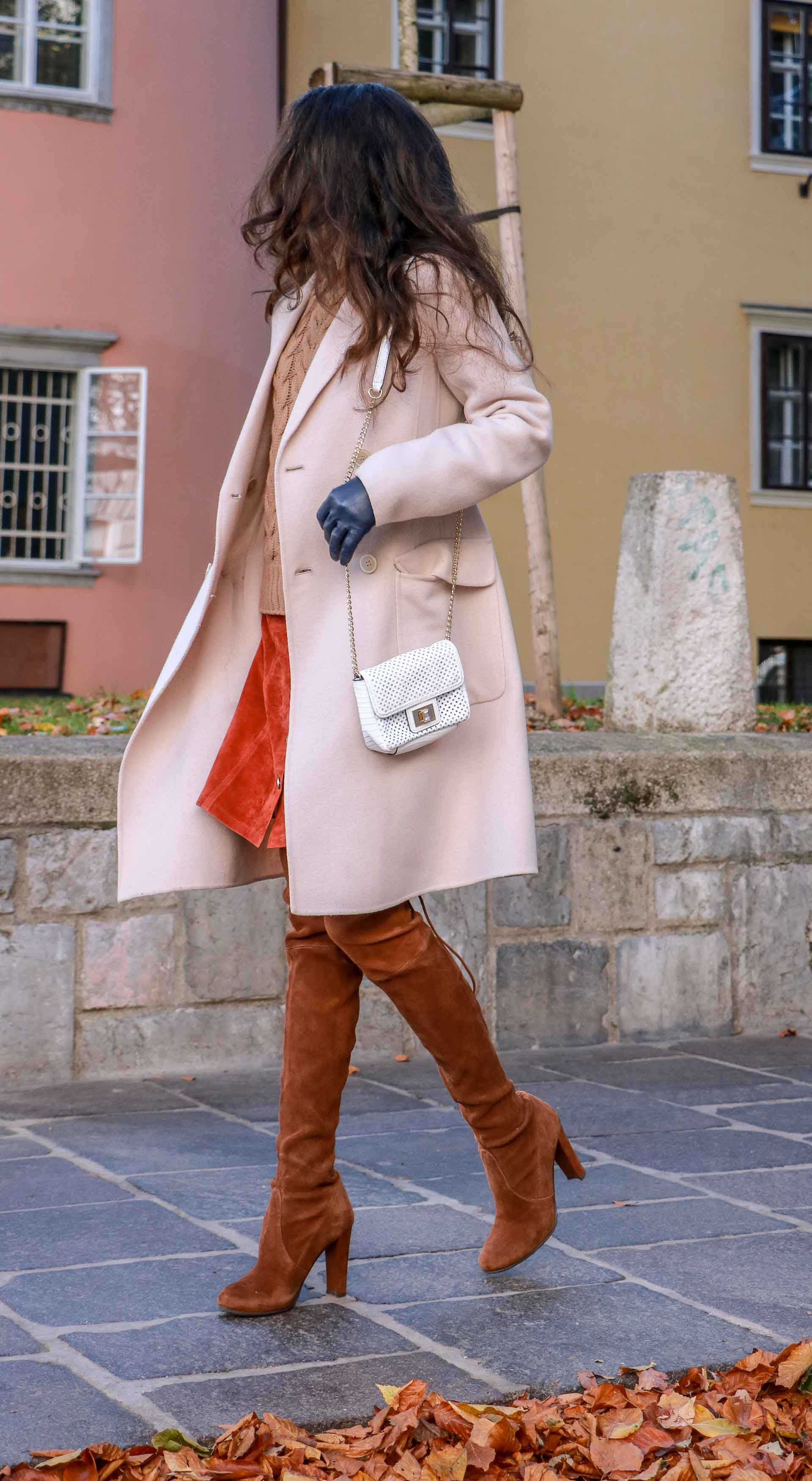Beautiful Slovenian Fashion Blogger Veronika Lipar of Brunette from Wall wearing Max Mara camel cable knit sweater, front button brown suede skirt, Stuart Weitzman brown over the knee boots, Max Mara coat running
