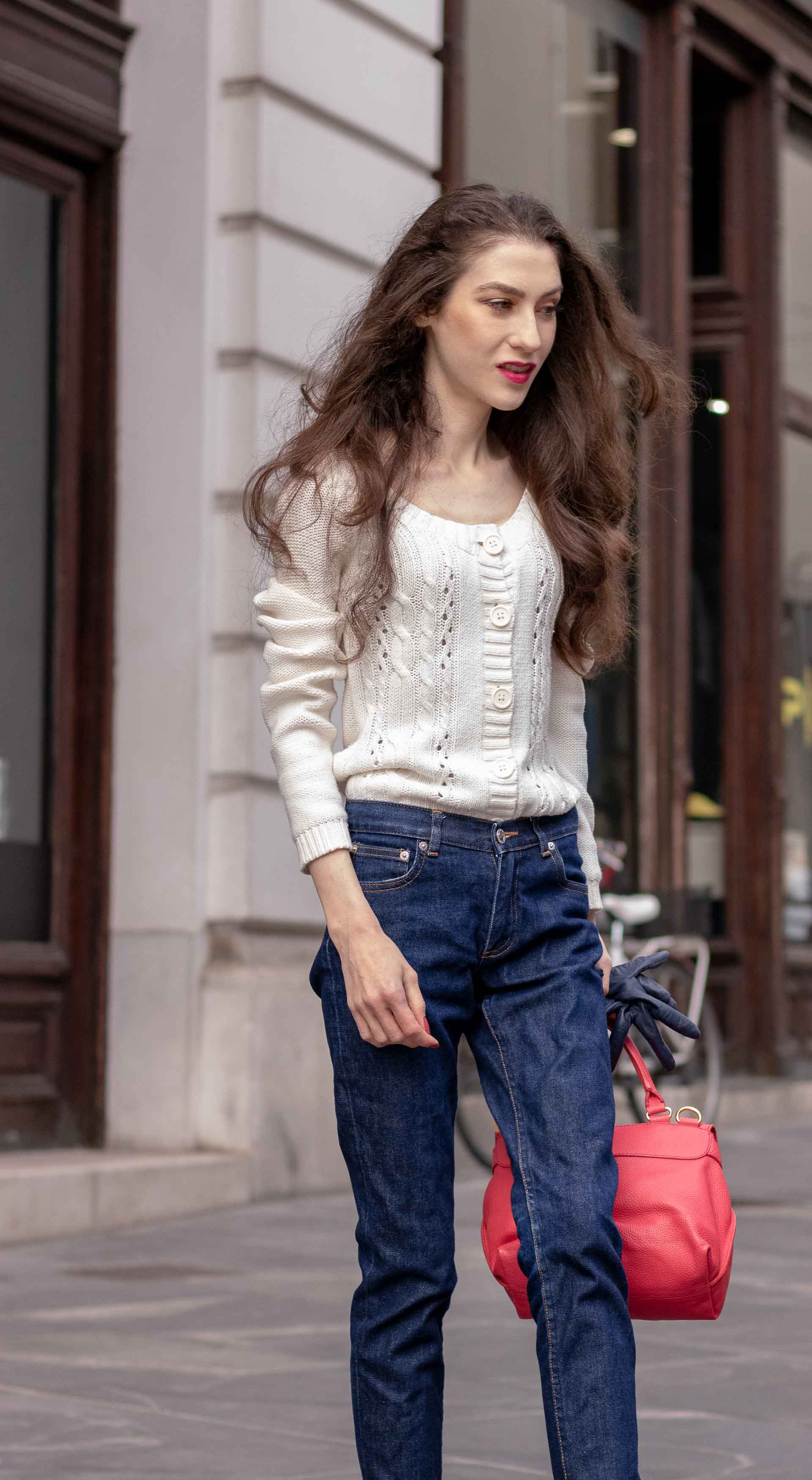 Beautiful Slovenian Fashion Blogger Veronika Lipar of Brunette from Wall wearing white Mango cardigan tucked into dark blue denim jeans from a.p.c., blue Gianvito Rossi pumps, pink top handle bag in autumn