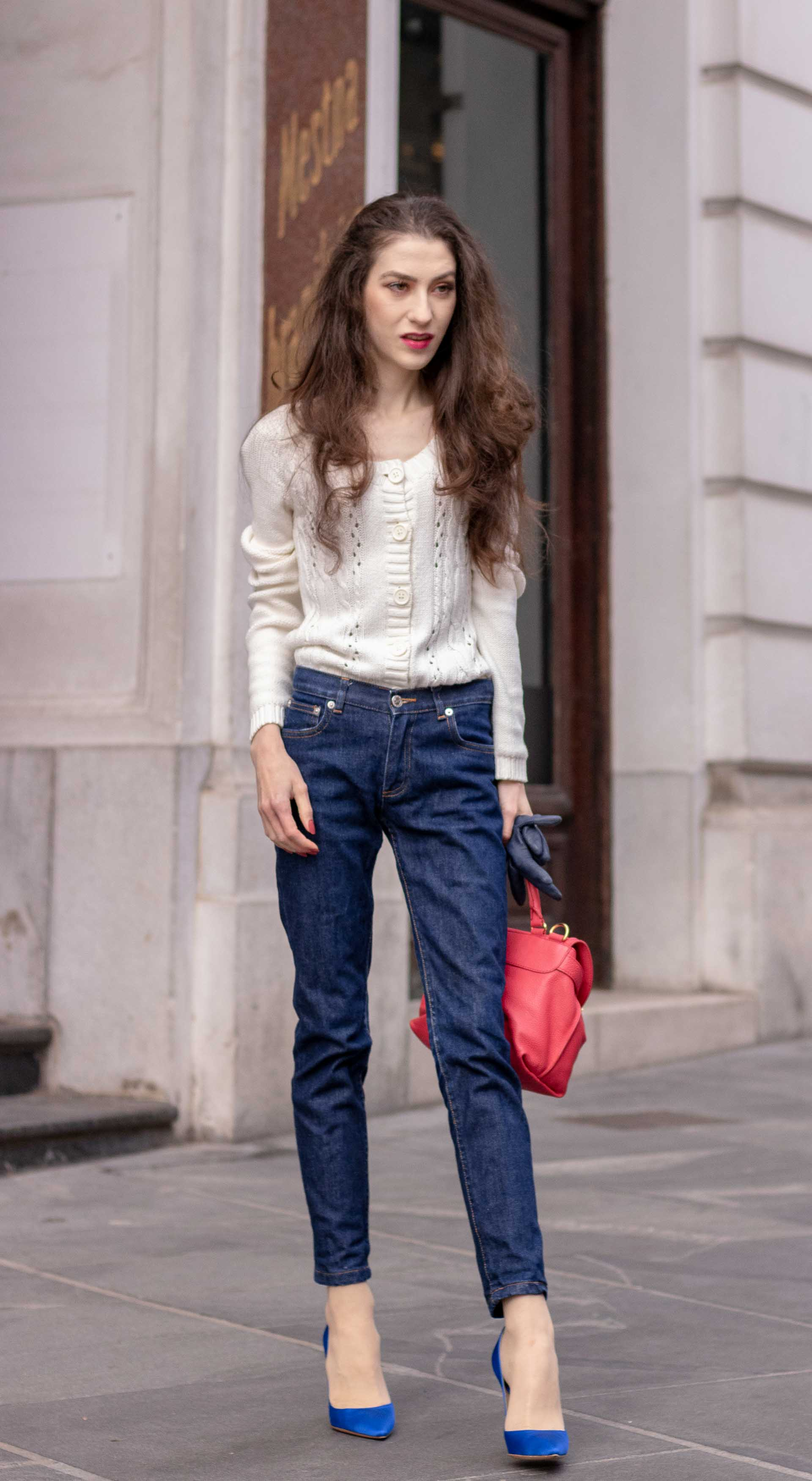 Beautiful Slovenian Fashion Blogger Veronika Lipar of Brunette from Wall dressed in white Mango cardigan tucked into dark blue denim jeans from a.p.c., blue Gianvito Rossi pumps, pink top handle bag in autumn