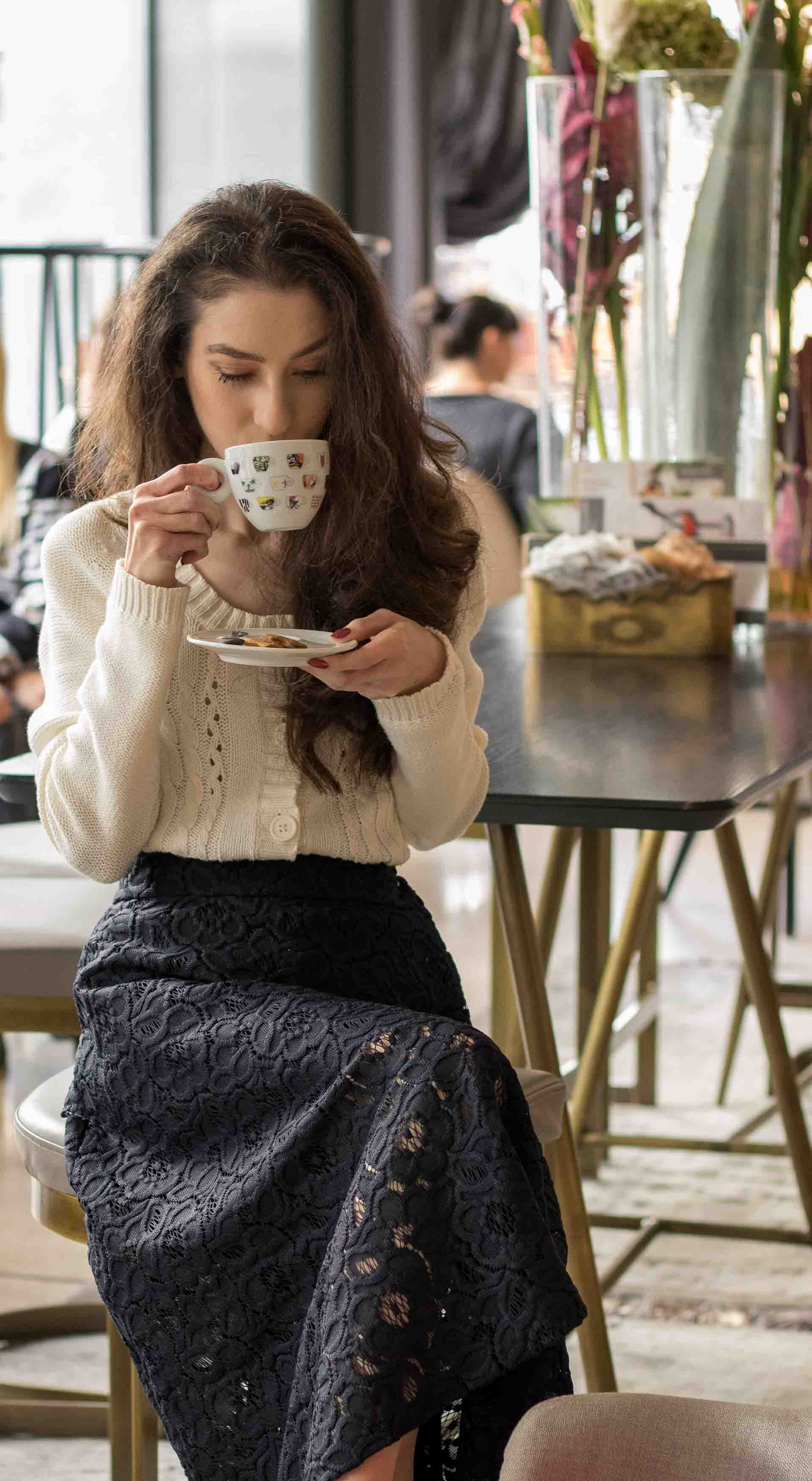 Beautiful Slovenian Fashion Blogger Veronika Lipar of Brunette from Wall dressed in white Mango cardigan etude into black lace midi skirt, blue Gianvito Rossi pumps for fall Sunday brunch drinking coffee