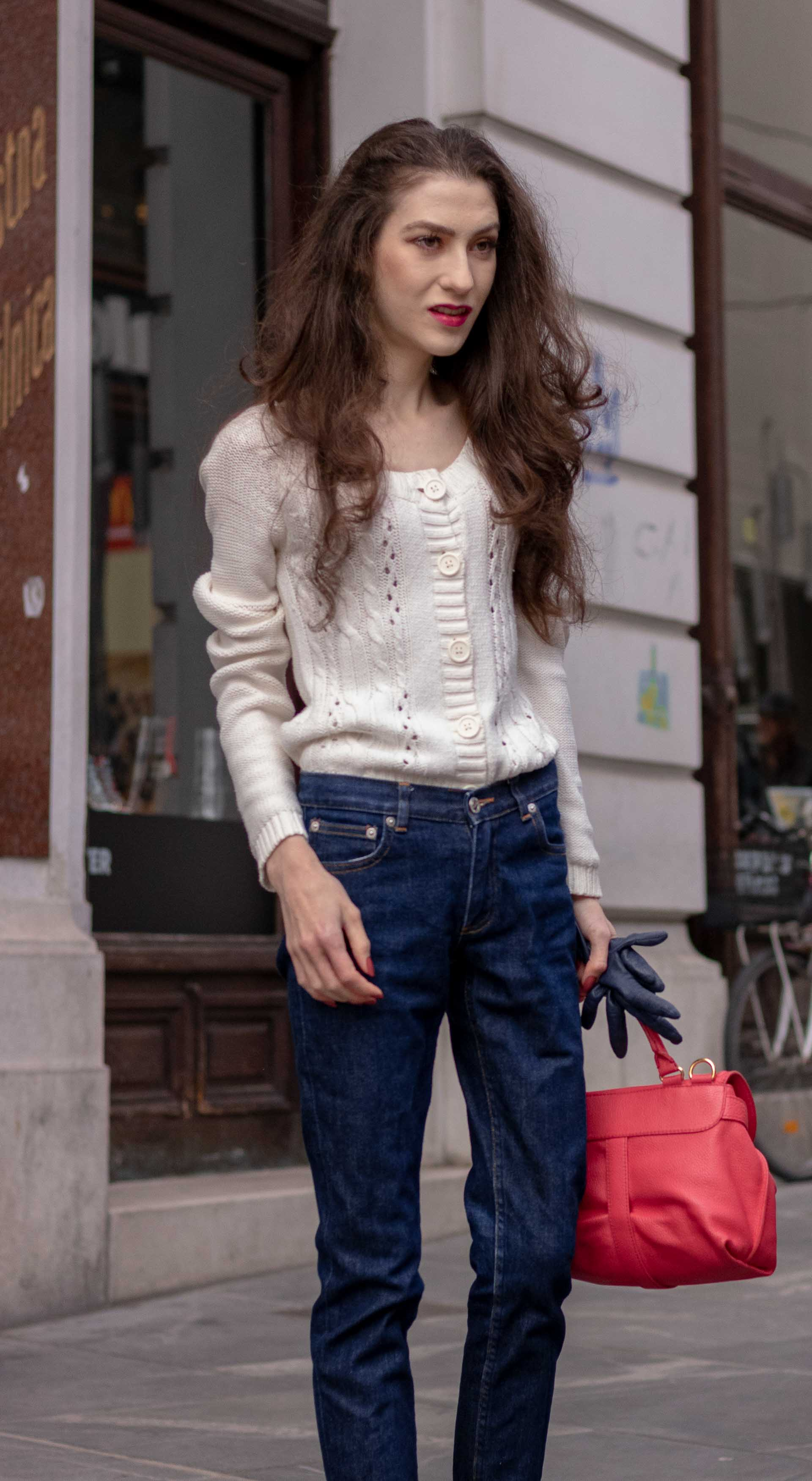 Beautiful Slovenian Fashion Blogger Veronika Lipar of Brunette from Wall wearing white Mango cardigan tucked into dark blue denim jeans from a.p.c., blue Gianvito Rossi pumps, pink top handle bag on the street