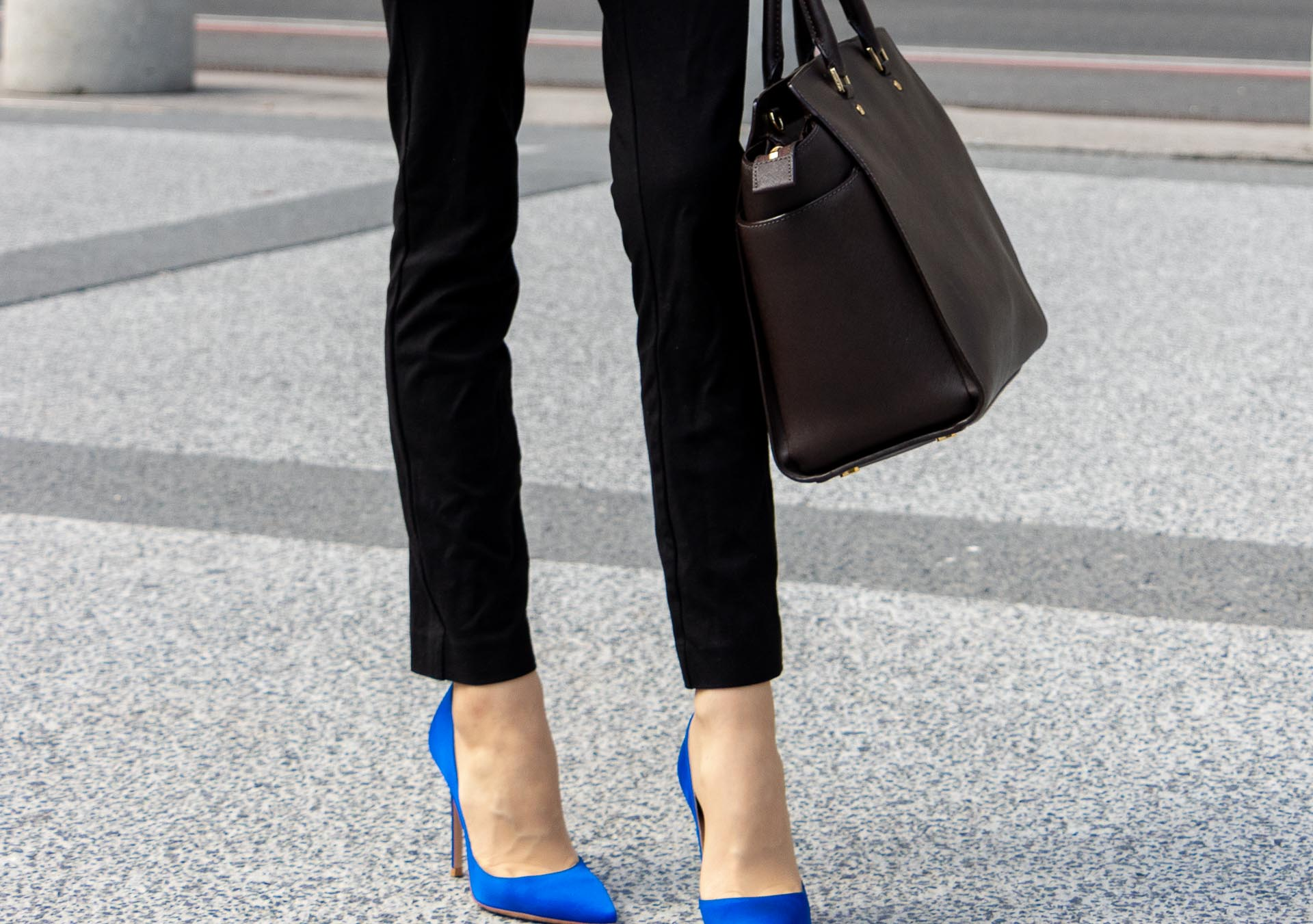 Beautiful Slovenian Fashion Blogger Veronika Lipar of Brunette from Wall dressed in black pants, brown Michael Kors selma top handle tote bag, Gianvito Rossi blue satin heels for work in autumn