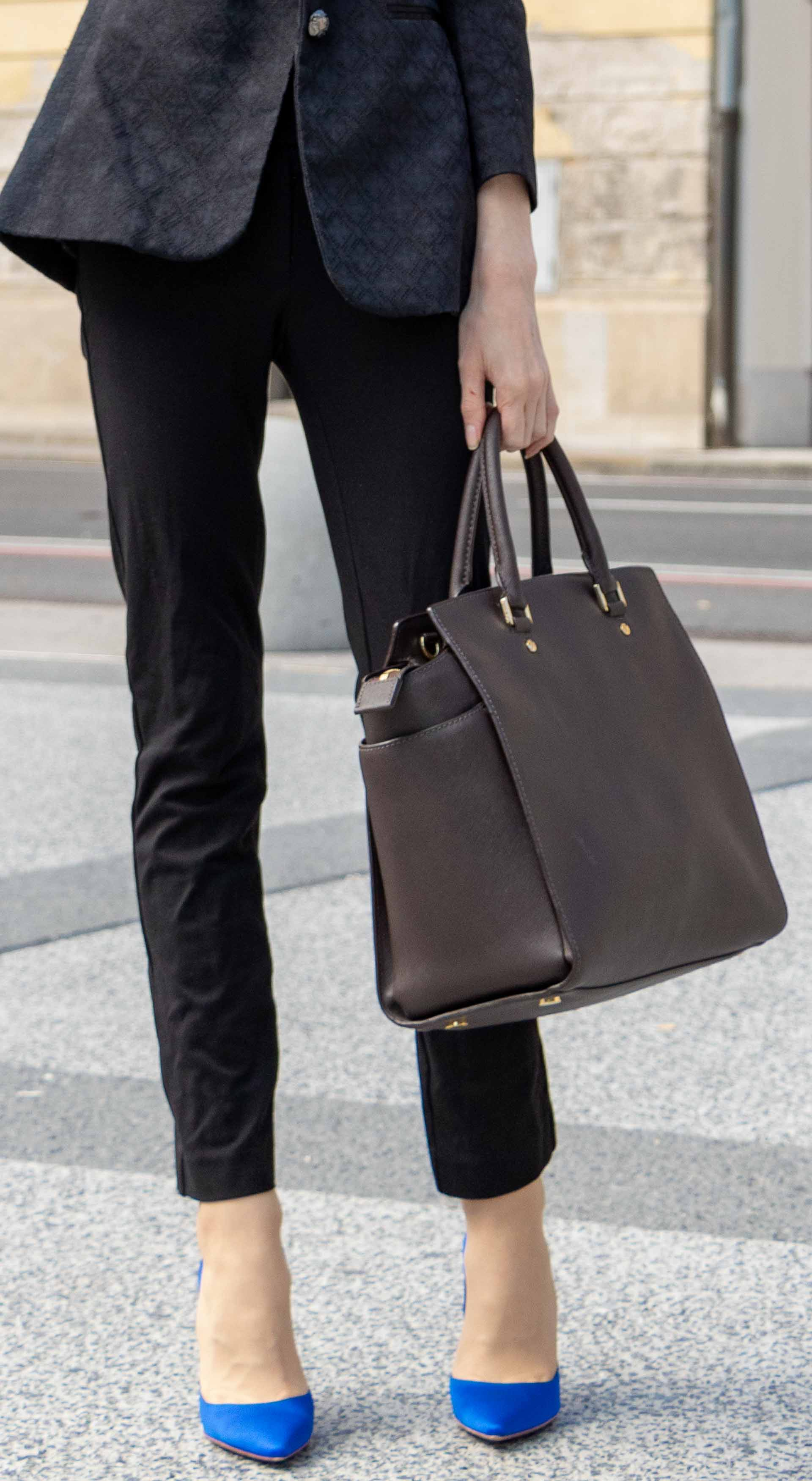 Beautiful Slovenian Fashion Blogger Veronika Lipar of Brunette from Wall dressed in black pantsuit, brown Michael Kors selma top handle tote bag, Gianvito Rossi blue satin pumps for work in autumn