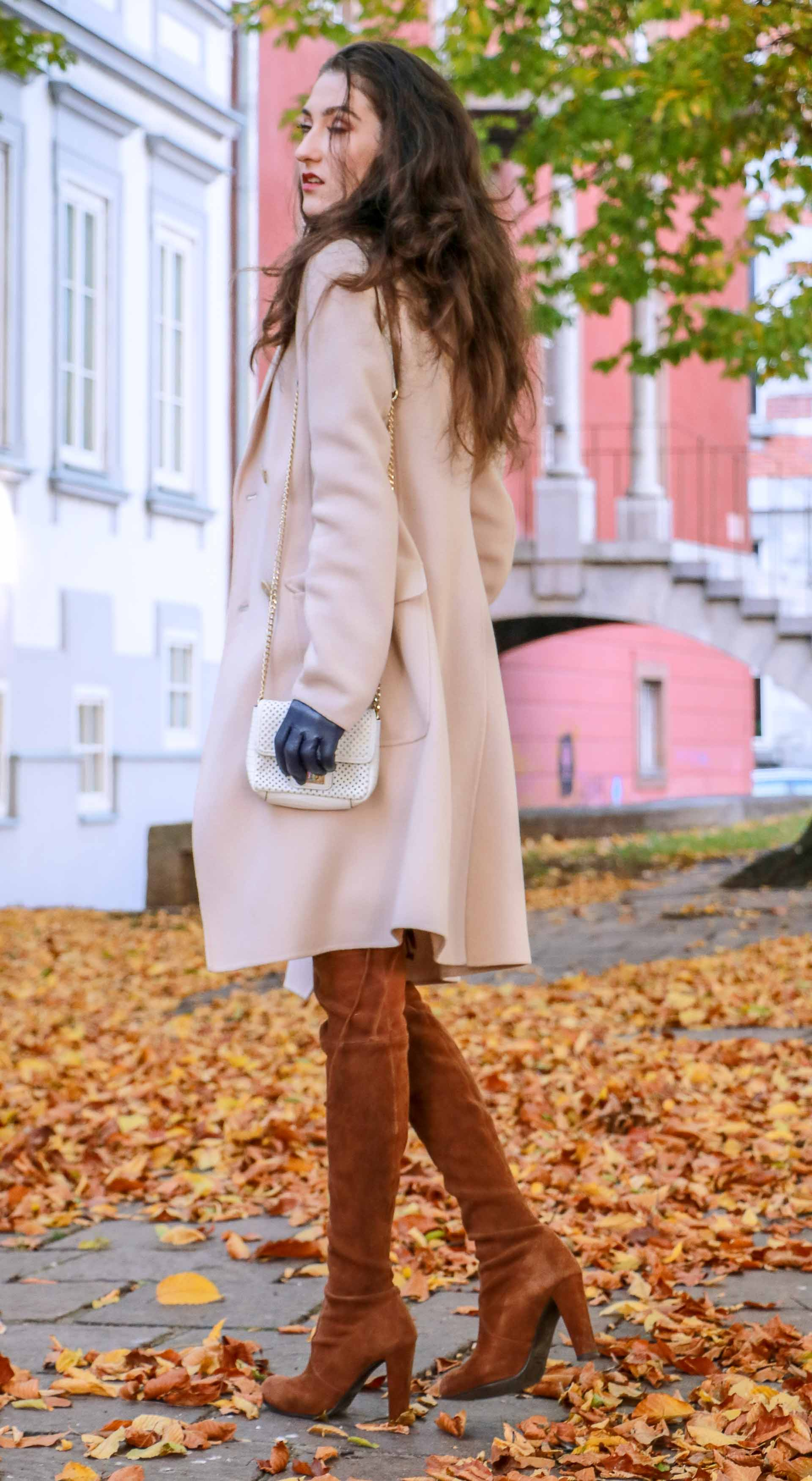 Beautiful Slovenian Fashion Blogger Veronika Lipar of Brunette from Wall wearing Max Mara coat, Stuart Weitzman brown over the knee boots, white chain strap bag