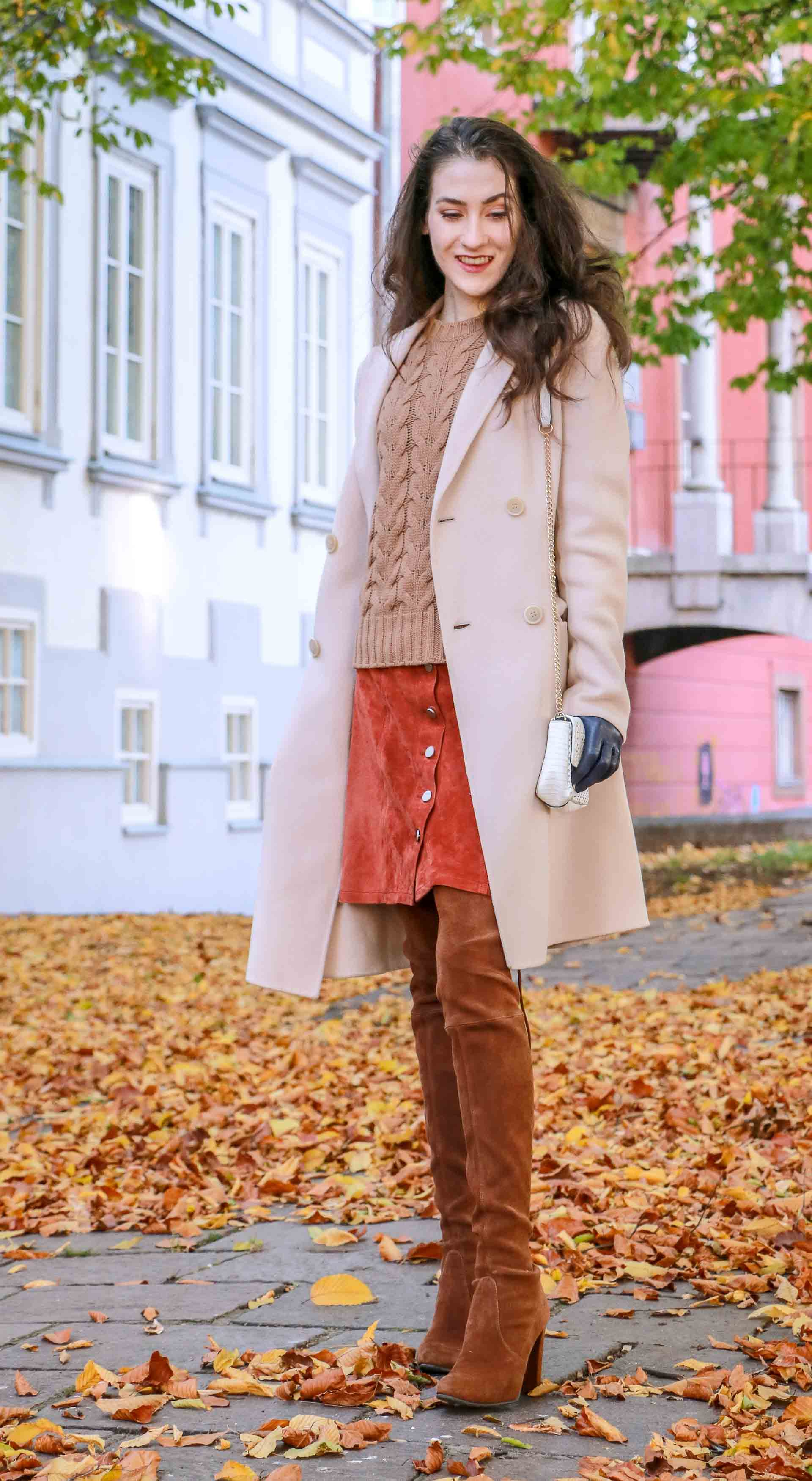 Beautiful Slovenian Fashion Blogger Veronika Lipar of Brunette from Wall wearing Max Mara camel cable knit sweater, front button brown suede skirt, Stuart Weitzman brown over the knee boots, Max Mara coat in autumn