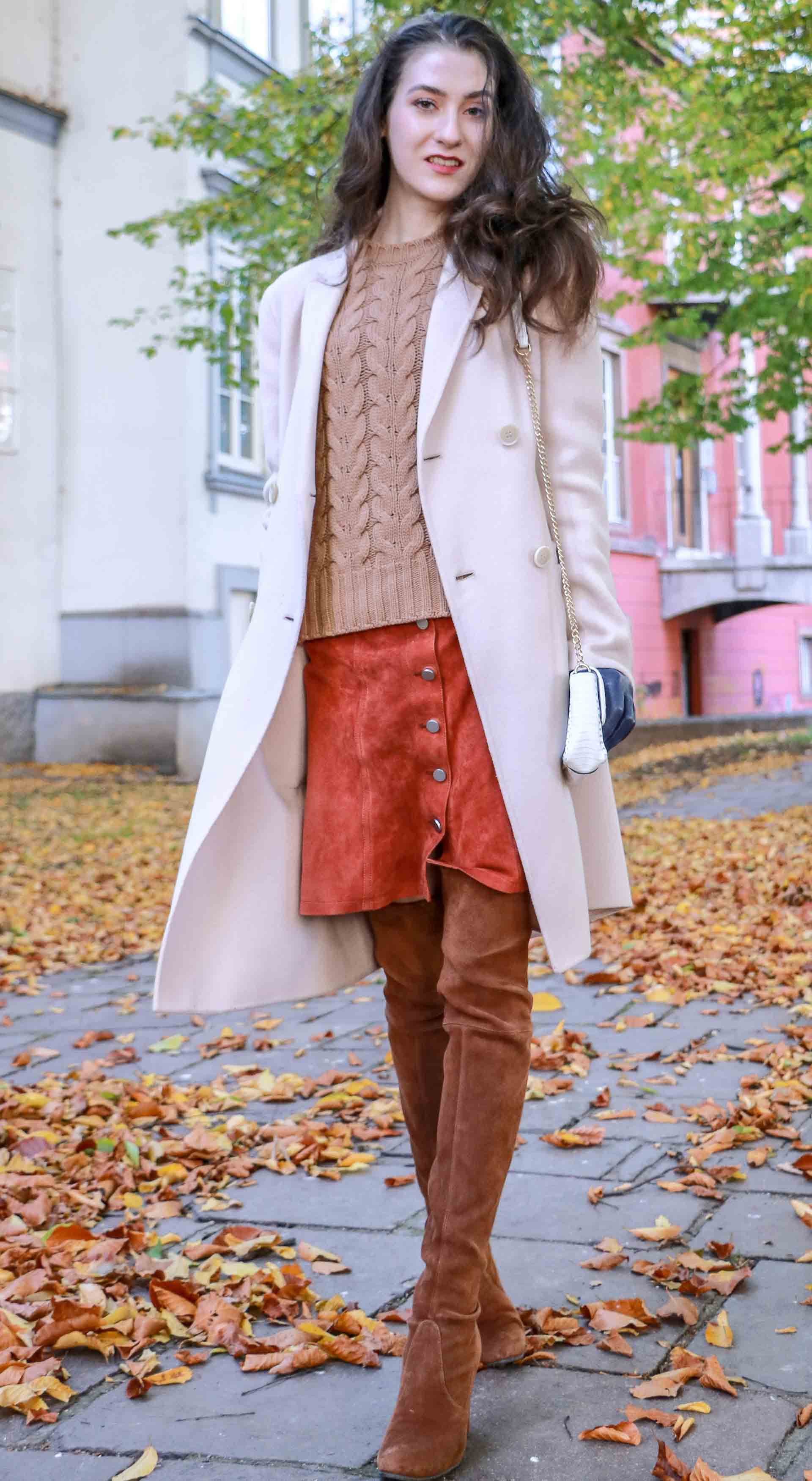Beautiful Slovenian Fashion Blogger Veronika Lipar of Brunette from Wall dressed in Max Mara camel cable knit sweater, front button brown suede skirt, Stuart Weitzman brown over the knee boots, Max Mara coat in autumn