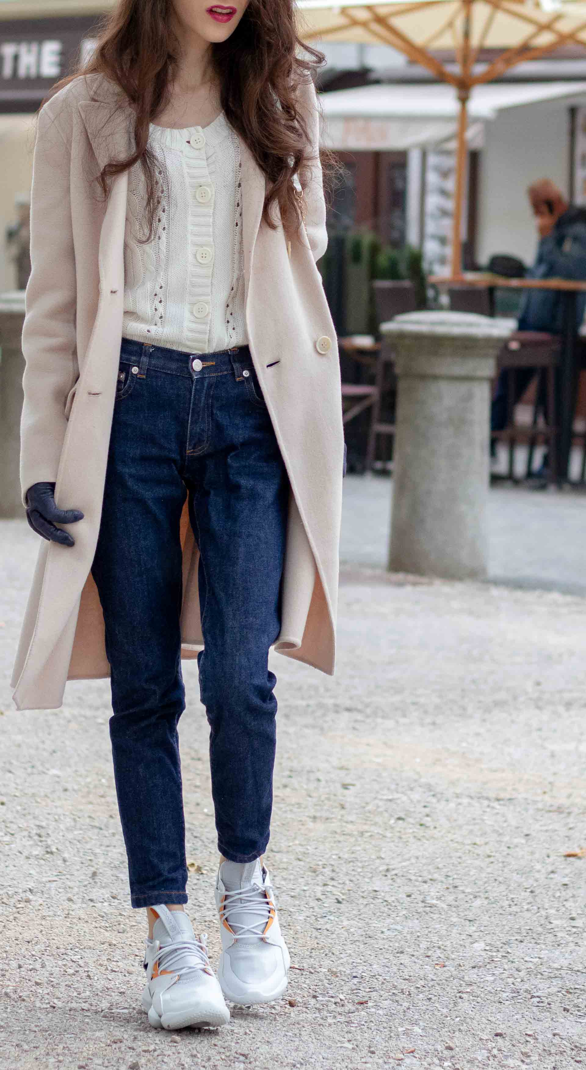 Beautiful Slovenian Fashion Blogger Veronika Lipar of Brunette from Wall wearing white Mango cardigan tucked into dark blue denim jeans from a.p.c., Weekend Max Mara coat, Reebok instapump sneakers every day