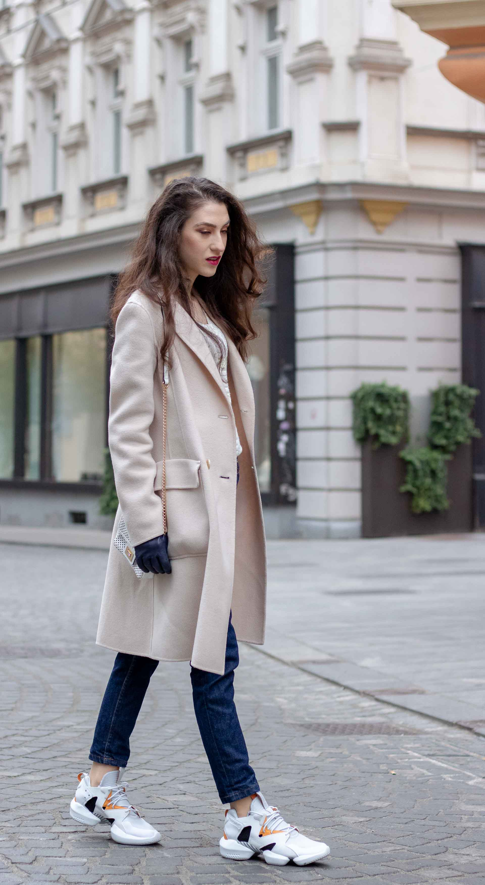 Beautiful Slovenian Fashion Blogger Veronika Lipar of Brunette from Wall dressed in A.P.C. dark blue denim jeans, Weekend Max Mara coat, Reebok instapump in Ljubljana