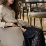 Beautiful Slovenian Fashion Blogger Veronika Lipar of Brunette from Wall dressed in white Mango cardigan etude into black lace midi skirt, blue Gianvito Rossi pumps for fall Sunday brunch with his parents