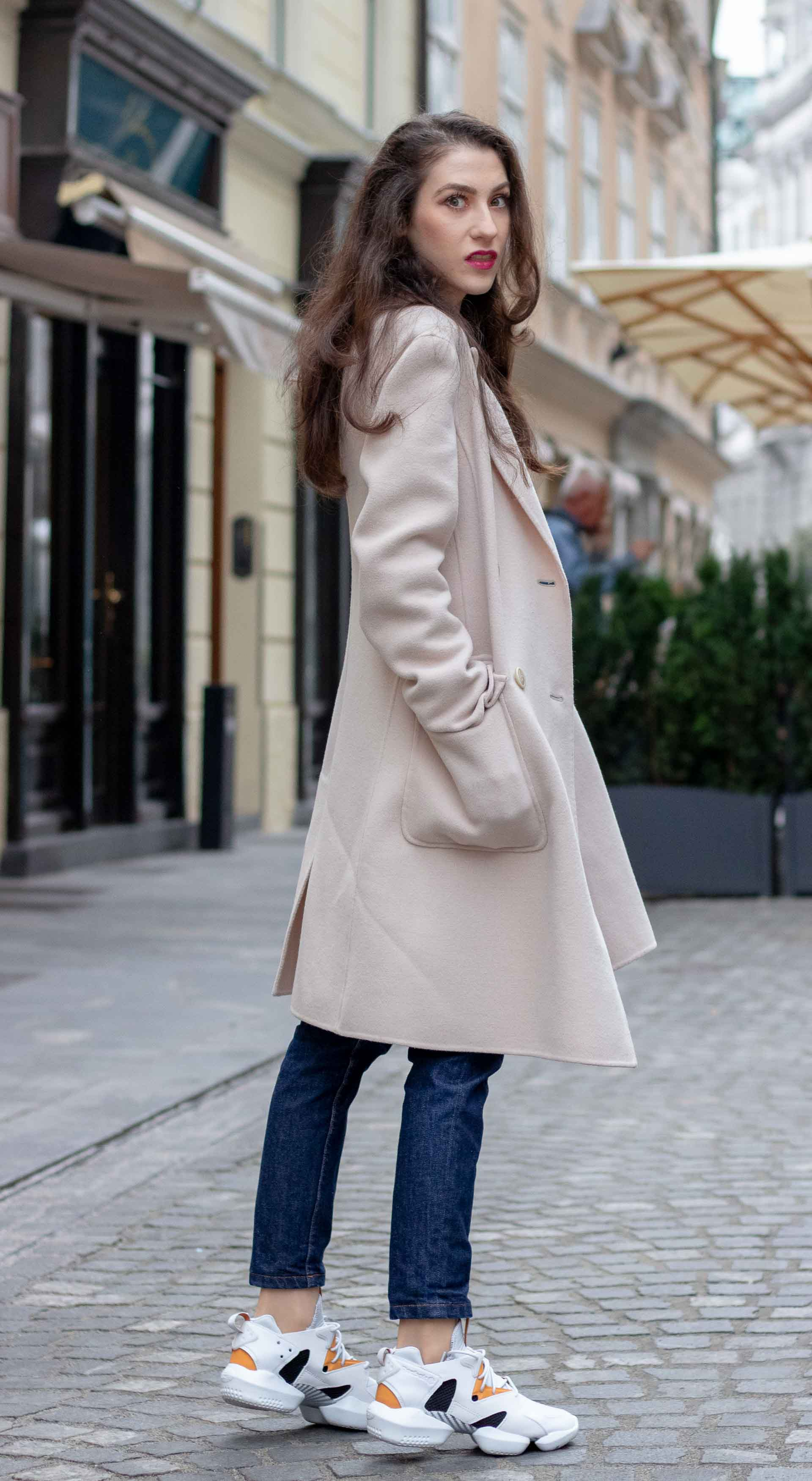 Beautiful Slovenian Fashion Blogger Veronika Lipar of Brunette from Wall dressed in A.P.C. dark blue denim jeans, Weekend Max Mara coat, Reebok instapump sneakers in fall