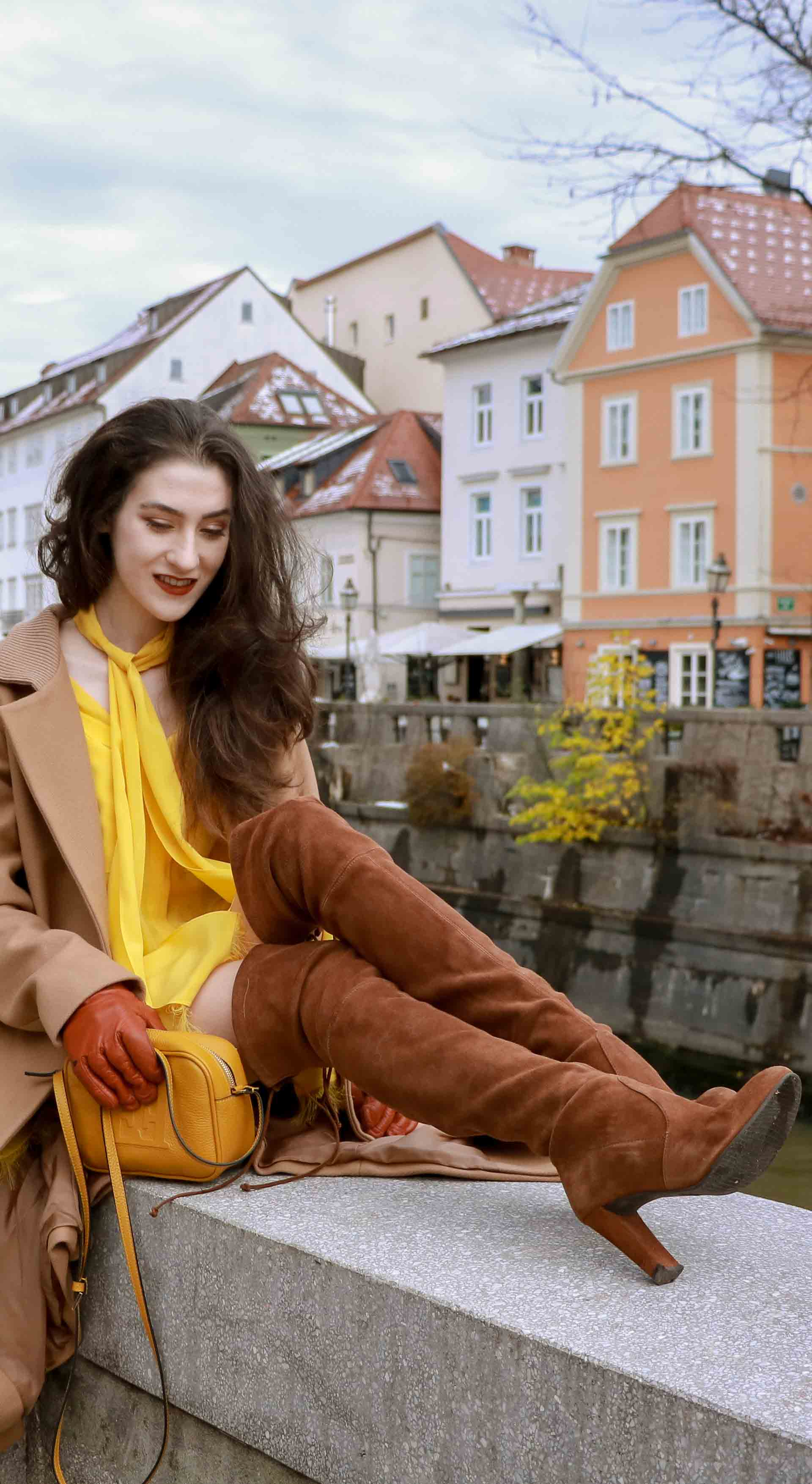 Beautiful Slovenian Fashion Blogger Veronika Lipar of Brunette from Wall dressed in Escada camel wrap coat, Escada yellow dress, Stuart Weitzman brown over the knee boots, Escada yellow shoulder bag for a day date in autumn