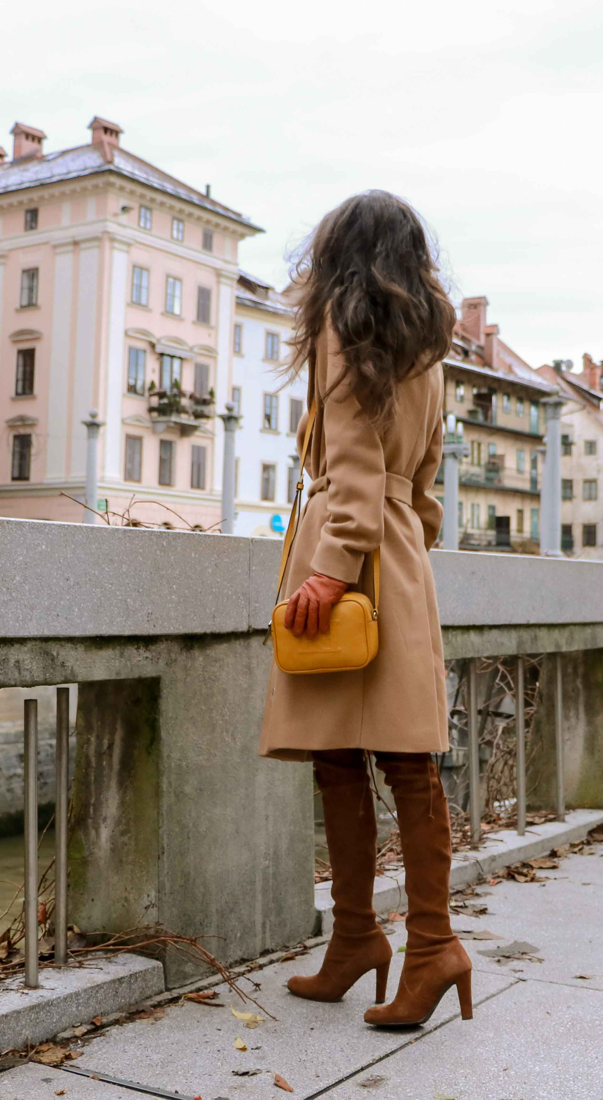 Beautiful Slovenian Fashion Blogger Veronika Lipar of Brunette from Wall wearing Escada camel wrap coat, Stuart Weitzman brown over the knee boots, Escada yellow shoulder bag for a day date in autumn