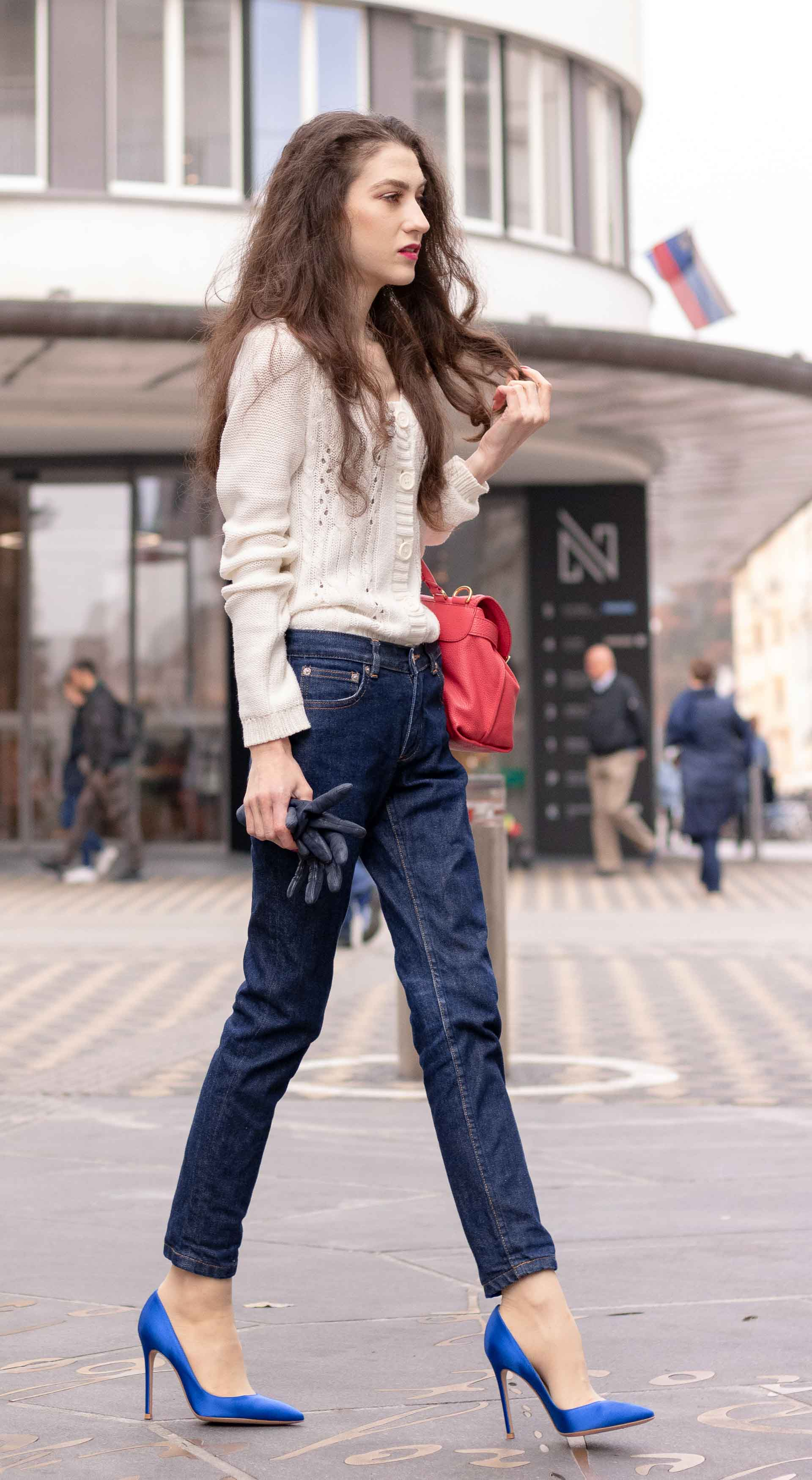 Beautiful Slovenian Fashion Blogger Veronika Lipar of Brunette from Wall dressed in white Mango cardigan tucked into dark blue denim jeans from a.p.c., blue Gianvito Rossi pumps, pink top handle bag on the street in Ljubljana