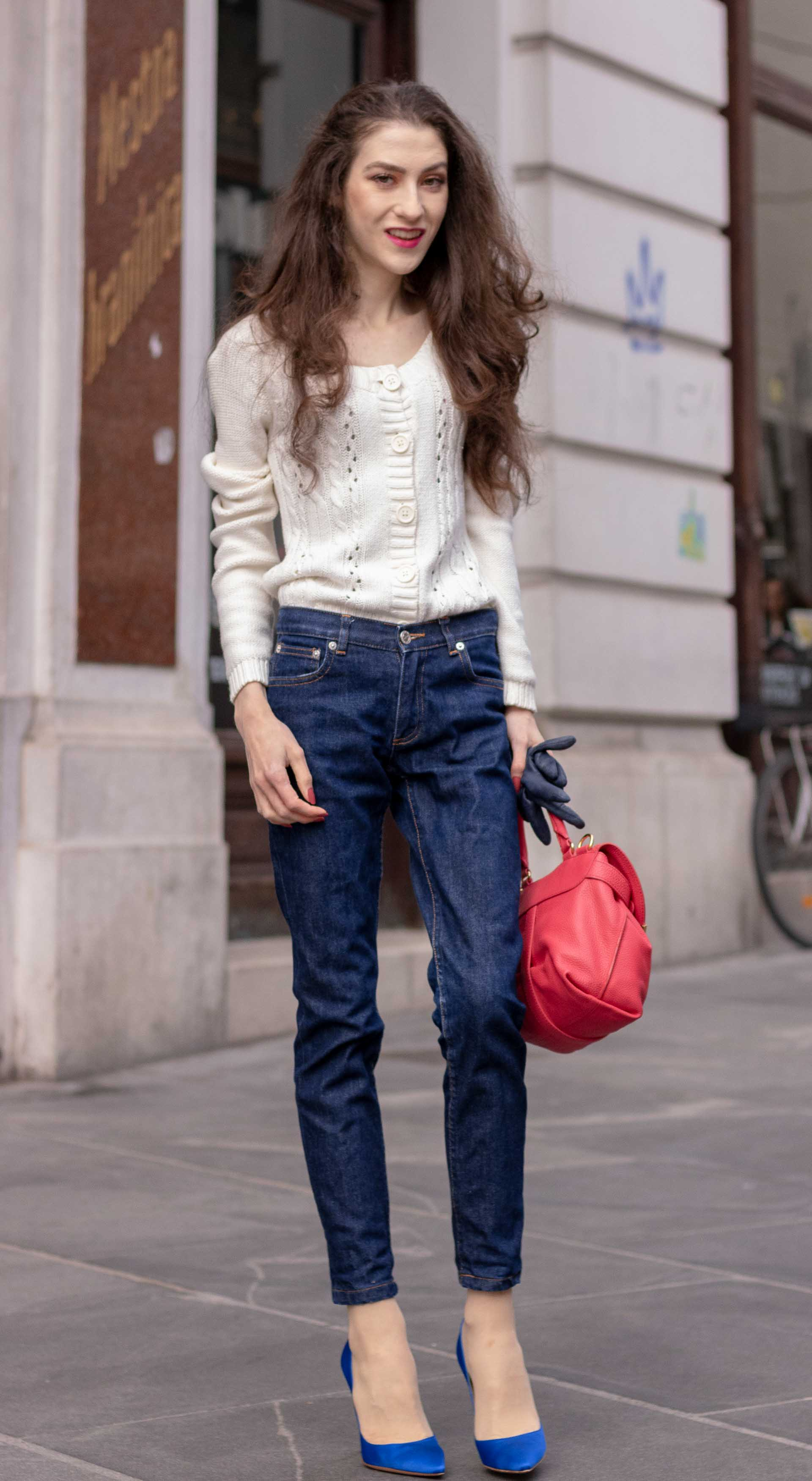 Beautiful Slovenian Fashion Blogger Veronika Lipar of Brunette from Wall wearing white Mango cardigan tucked into dark blue denim jeans from a.p.c., blue Gianvito Rossi pumps, pink top handle bag standing on the street