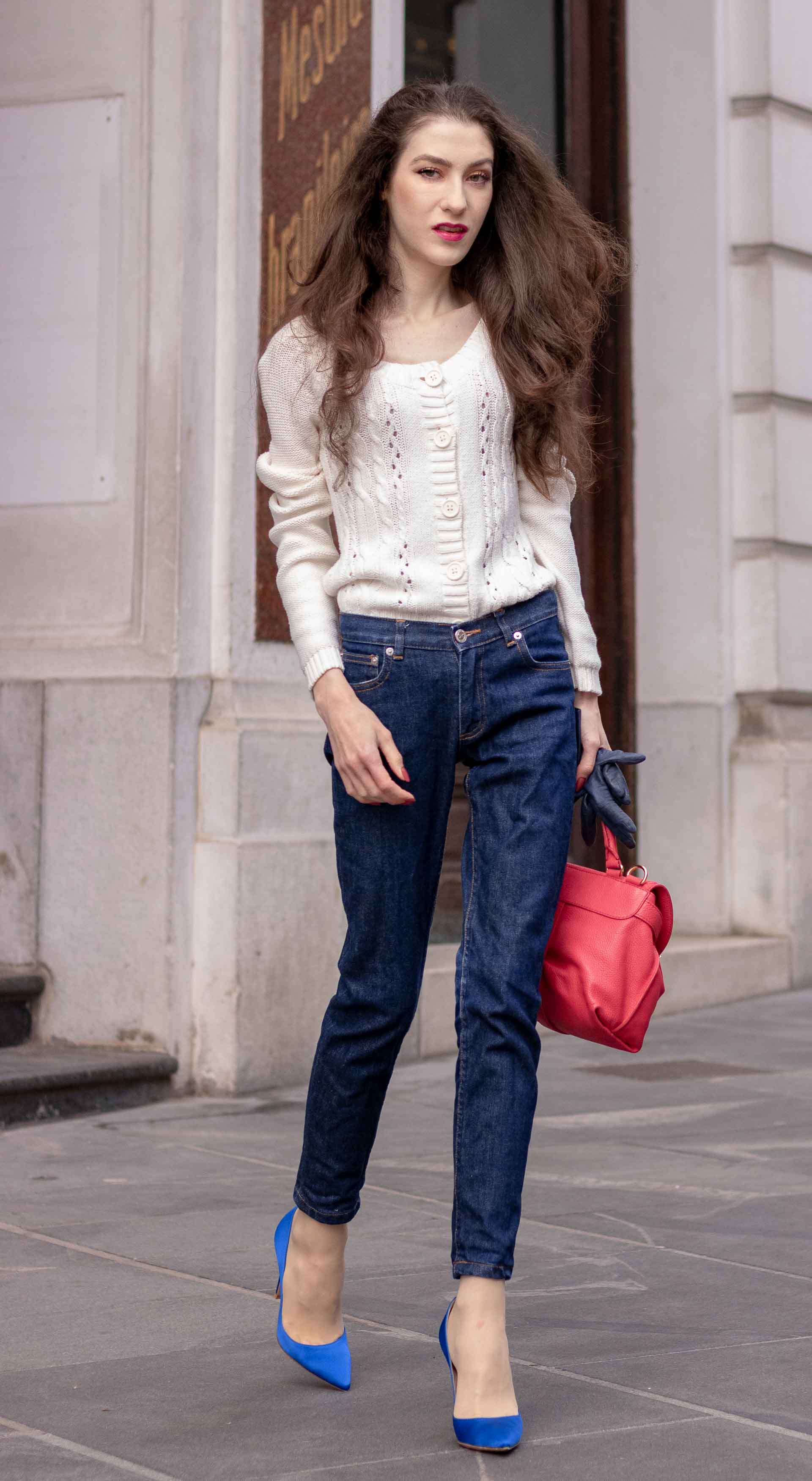 Beautiful Slovenian Fashion Blogger Veronika Lipar of Brunette from Wall wearing white Mango cardigan tucked into dark blue denim jeans from a.p.c., blue Gianvito Rossi pumps, pink top handle bag walking on the street
