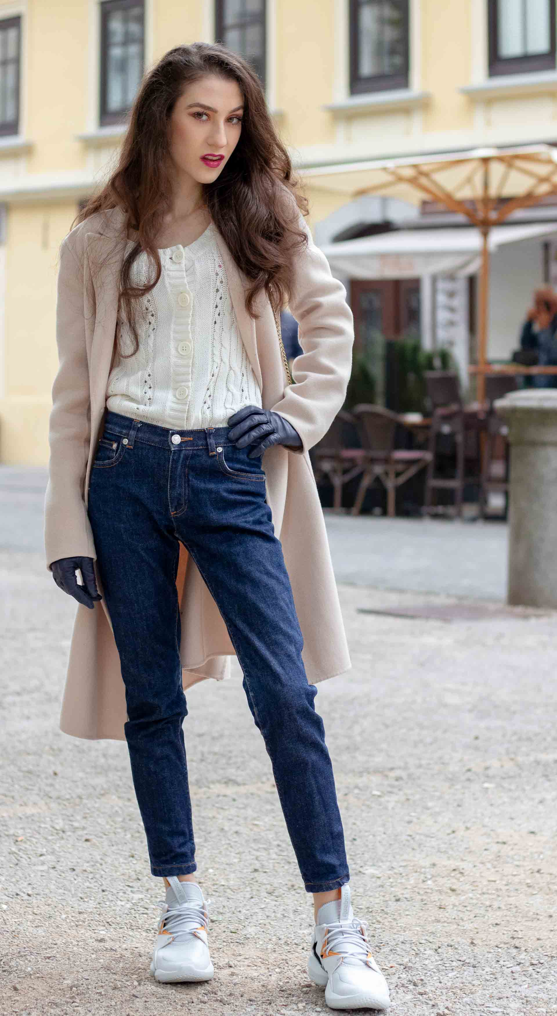 Beautiful Slovenian Fashion Blogger Veronika Lipar of Brunette from Wall wearing white Mango cardigan tucked into dark blue denim jeans from a.p.c., Weekend Max Mara coat, Reebok instapump sneakers again