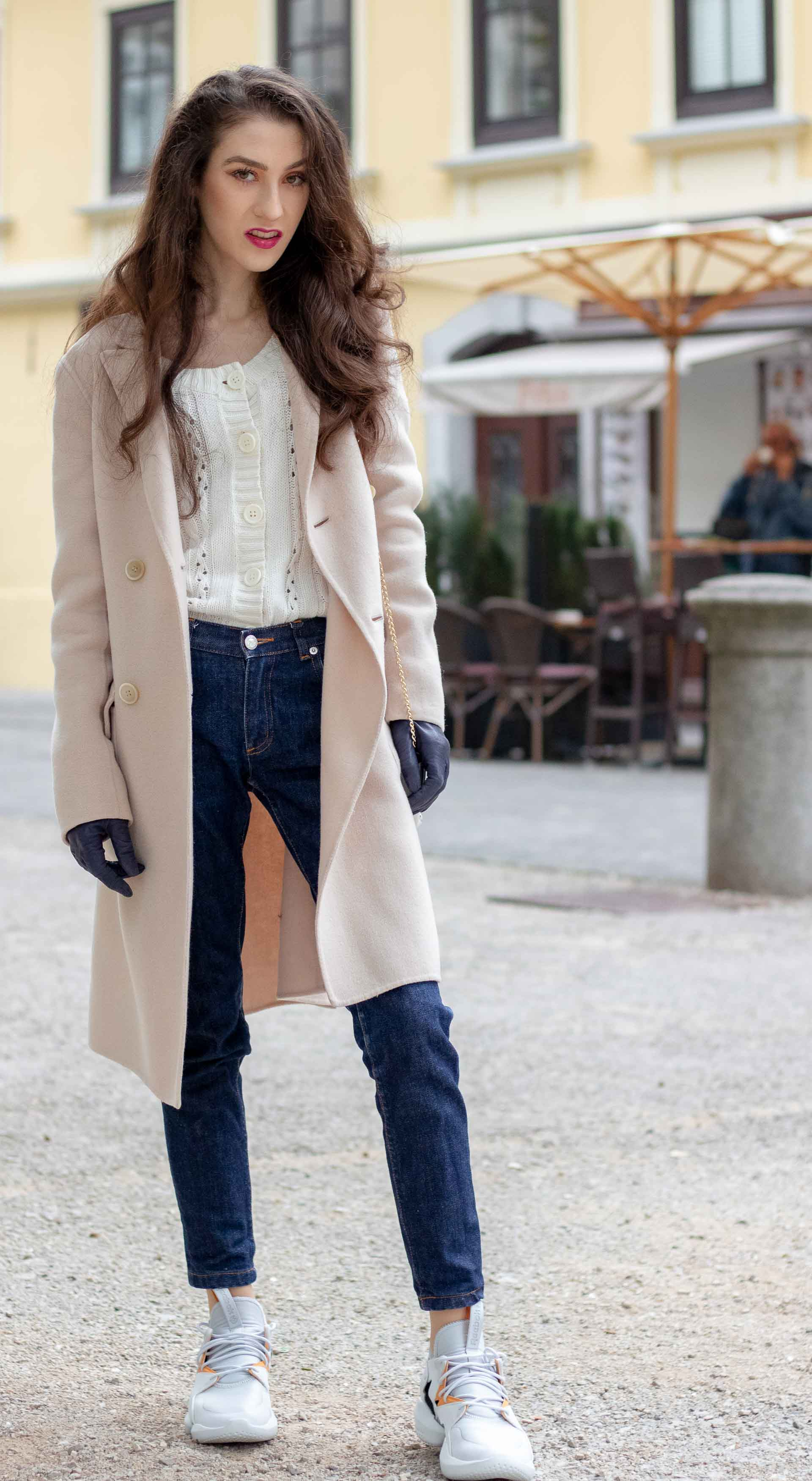 Beautiful Slovenian Fashion Blogger Veronika Lipar of Brunette from Wall dressed in white Mango cardigan tucked into A.P.C. dark blue denim jeans, Weekend Max Mara coat, Reebok instapump sneakers in fall