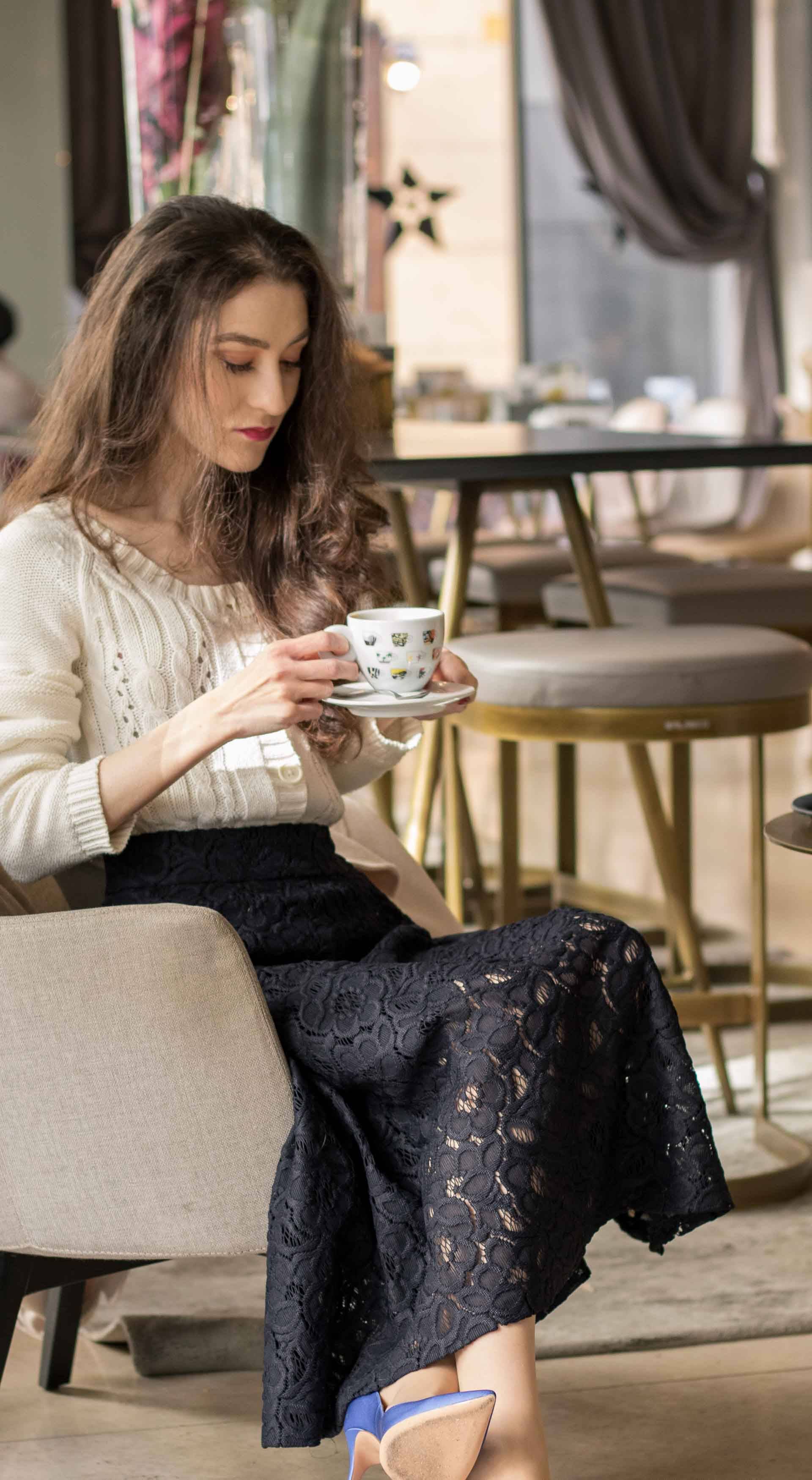 Beautiful Slovenian Fashion Blogger Veronika Lipar of Brunette from Wall dressed in white Mango cardigan etude into black lace midi skirt, blue Gianvito Rossi pumps for fall Sunday brunch holding cup of tea