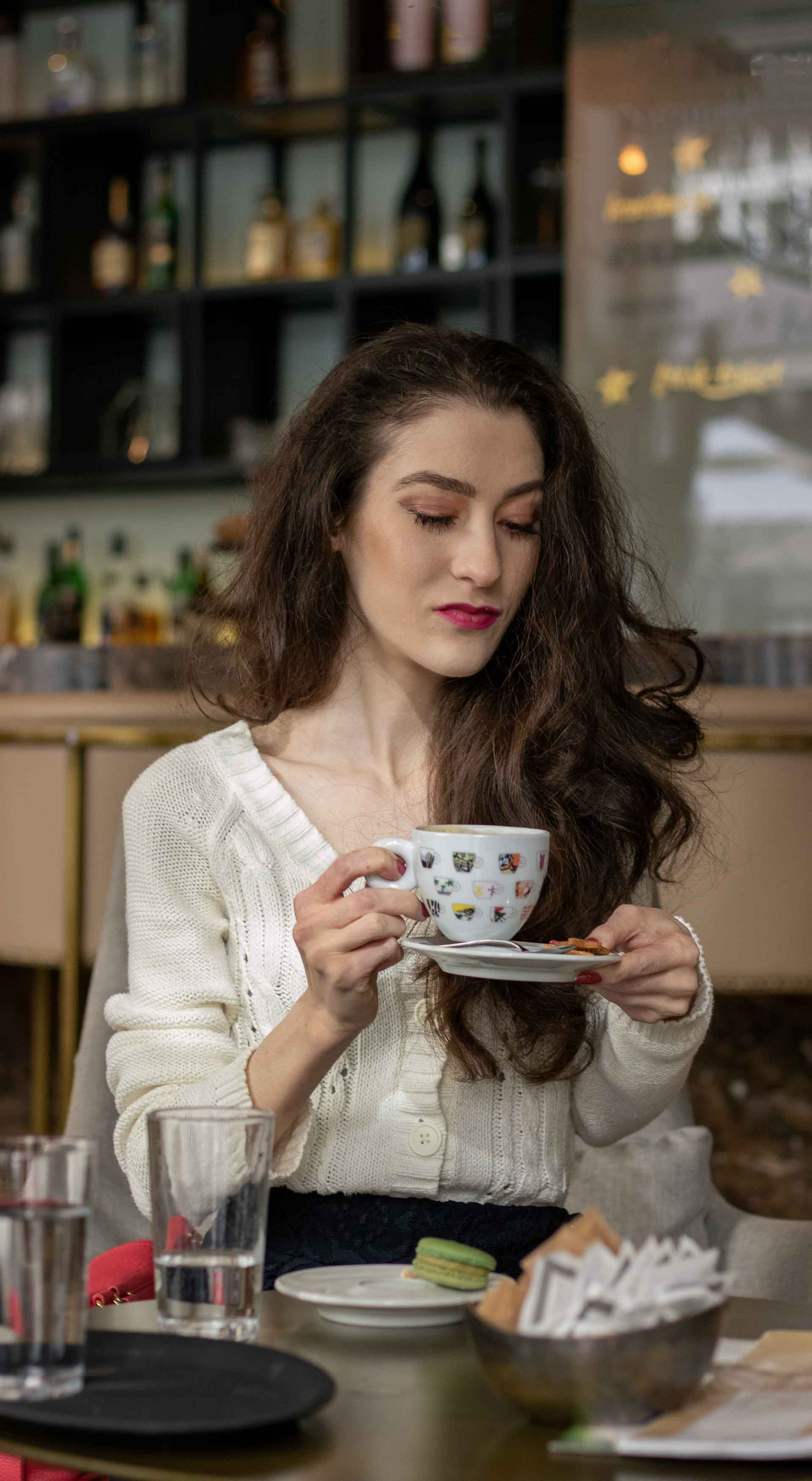 Beautiful Slovenian Fashion Blogger Veronika Lipar of Brunette from Wall wearing white Mango cardigan etude into black lace midi skirt, blue Gianvito Rossi pumps for fall Sunday brunch holding teacup