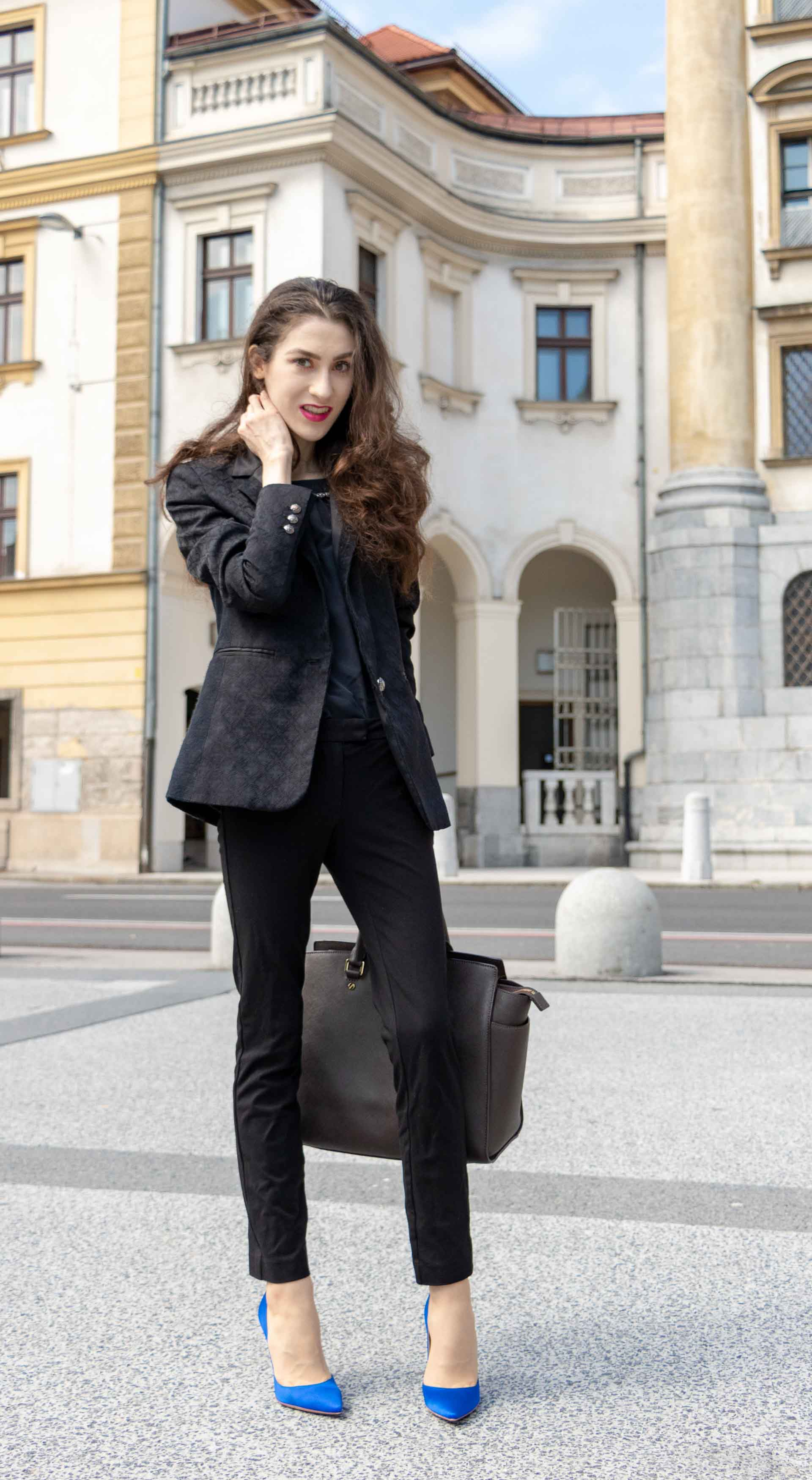 Beautiful Slovenian Fashion Blogger Veronika Lipar of Brunette from Wall wearing black pantsuit, brown Michael Kors selma top handle tote bag, Gianvito Rossi blue satin pumps for work in autumn