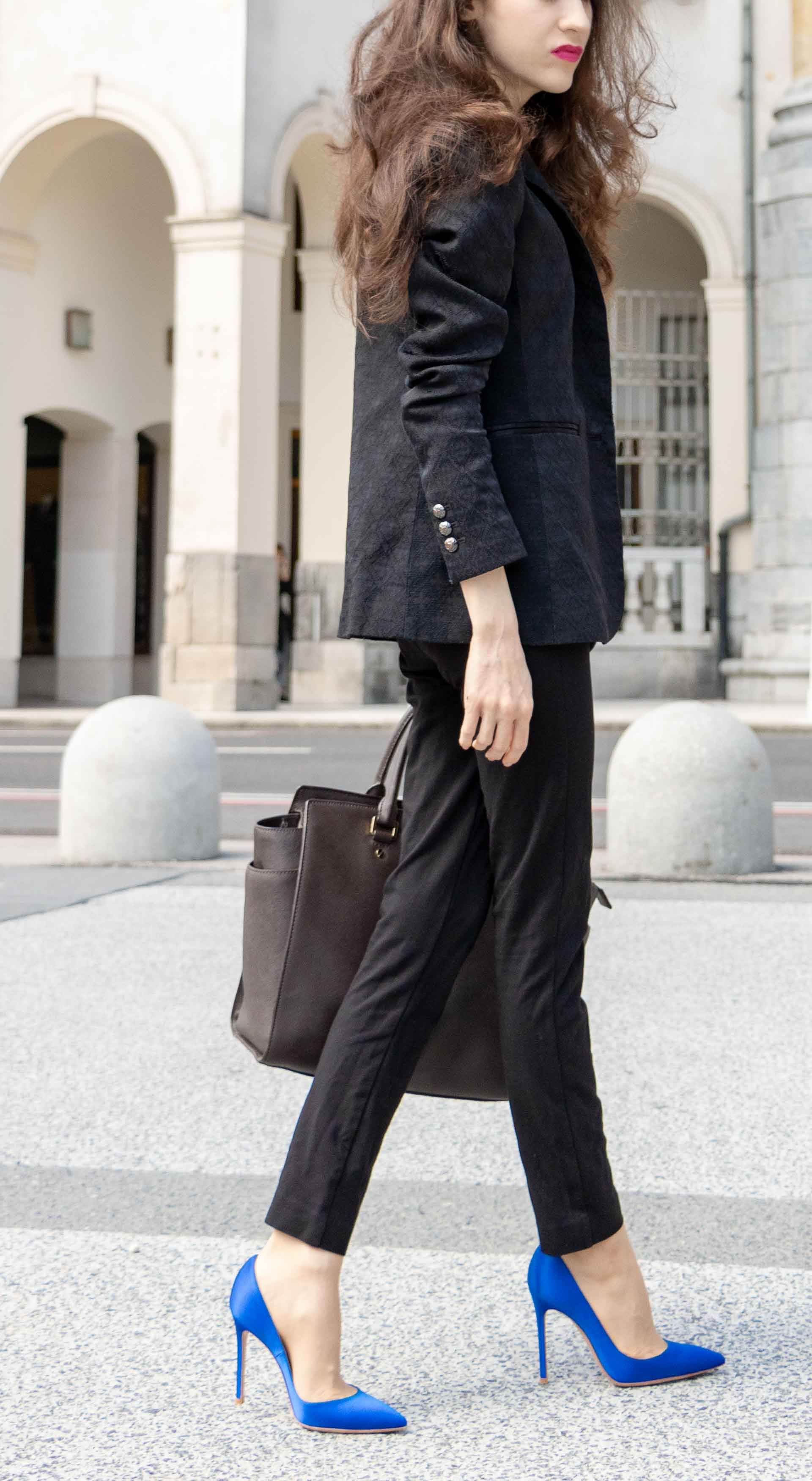Beautiful Slovenian Fashion Blogger Veronika Lipar of Brunette from Wall dressed in wearing black pantsuit, brown Michael Kors selma top handle tote bag, Gianvito Rossi blue satin court shoes for work