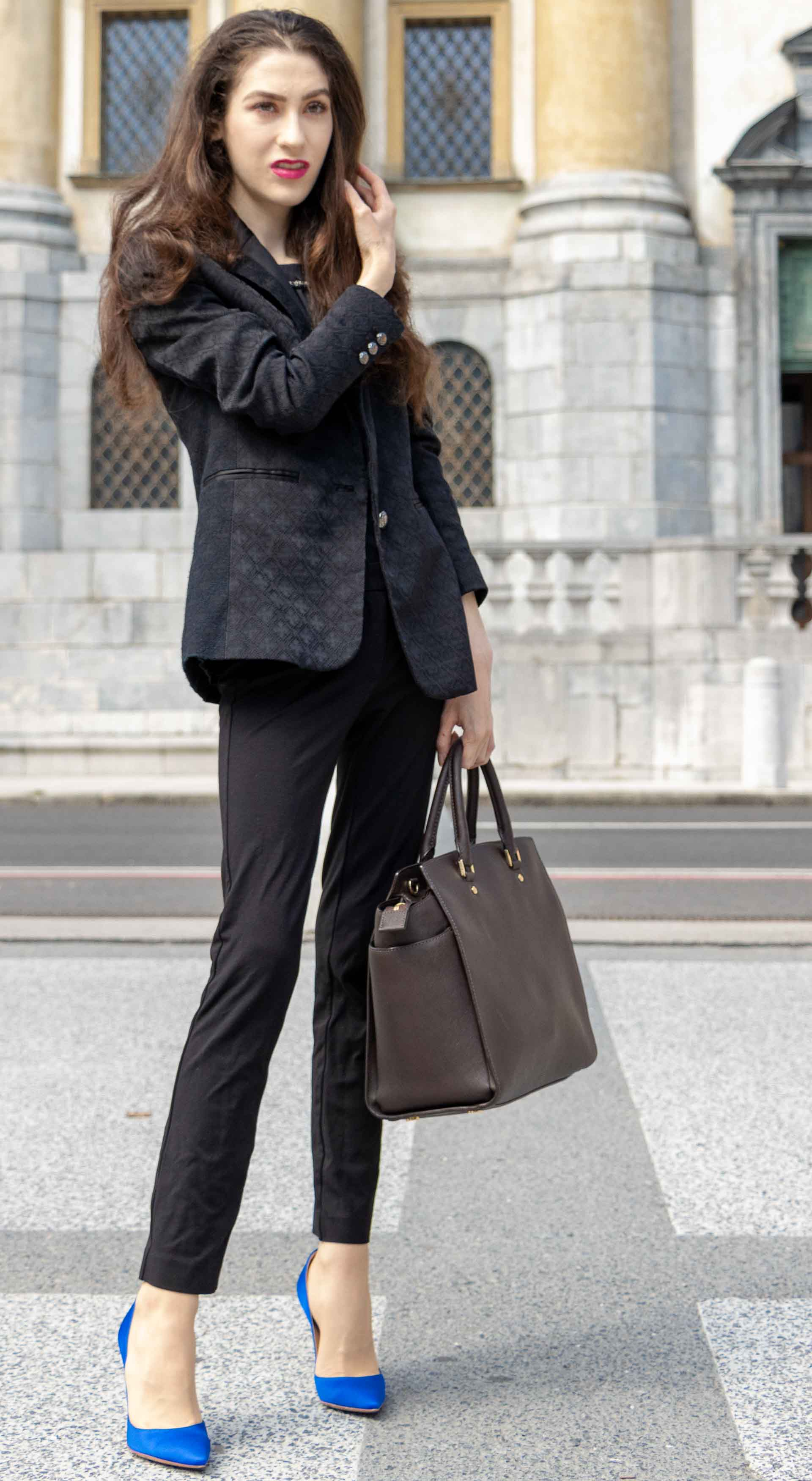 Beautiful Slovenian Fashion Blogger Veronika Lipar of Brunette from Wall wearing black pantsuit, brown Michael Kors selma top handle tote bag, Gianvito Rossi blue satin courts for work in fall