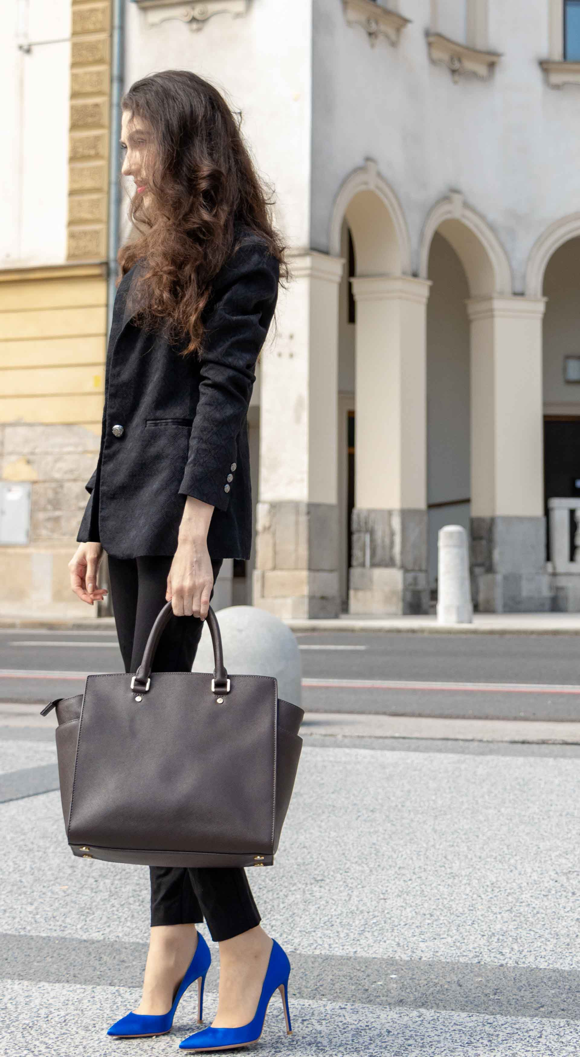 Beautiful Slovenian Fashion Blogger Veronika Lipar of Brunette from Wall dressed in black pantsuit, brown Michael Kors selma top handle tote bag, Gianvito Rossi blue satin pumps for work in fall