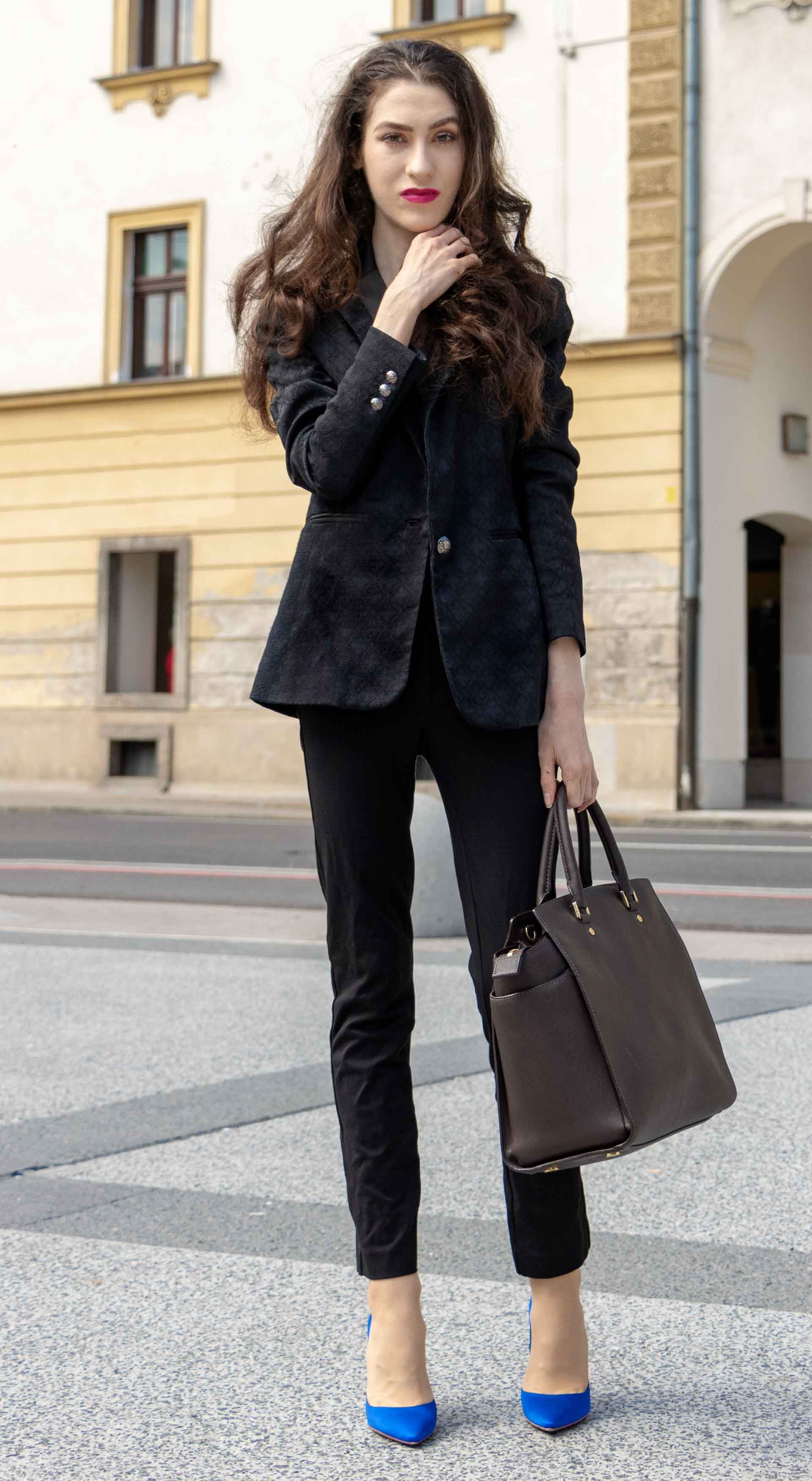 Beautiful Slovenian Fashion Blogger Veronika Lipar of Brunette from Wall wearing black pantsuit, brown Michael Kors selma top handle tote bag, Gianvito Rossi blue satin courts for work in autumn