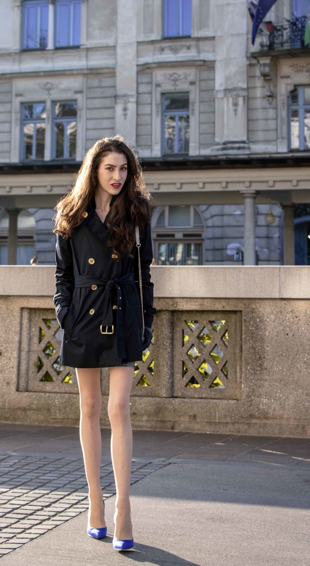 Beautiful Slovenian Fashion Blogger Veronika Lipar of Brunette from Wall wearing dark navy Michael Kors short trench coat, Gianvito Rossi blue satin court shoes, white chain shoulder bag for a night out with friends