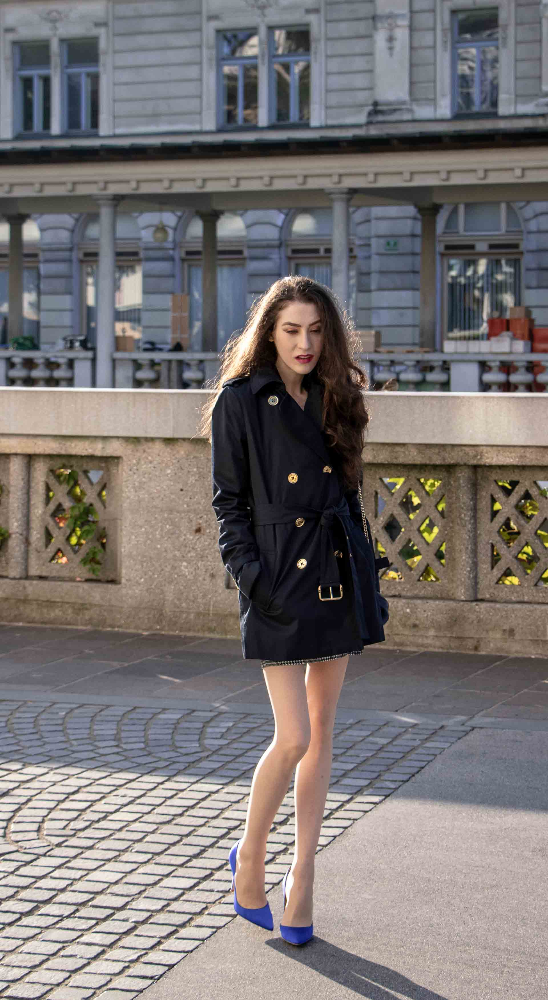 Beautiful Slovenian Fashion Blogger Veronika Lipar of Brunette from Wall wearing dark navy Michael Kors short trench coat, Gianvito Rossi blue satin court shoes, white chain shoulder bag after clubbing
