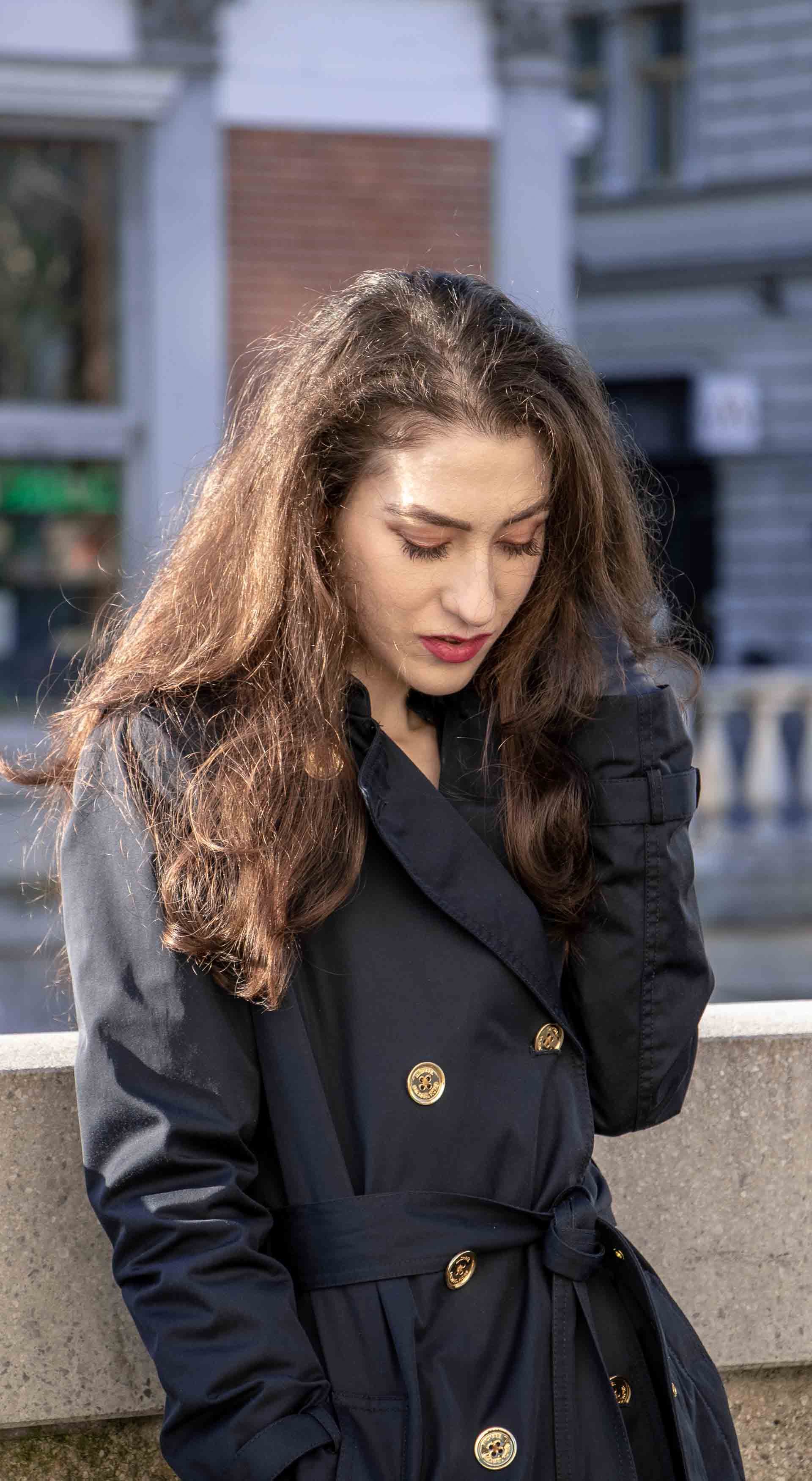 Beautiful Slovenian Fashion Blogger Veronika Lipar of Brunette from Wall wearing dark navy Michael Kors short trench coat morning after night out