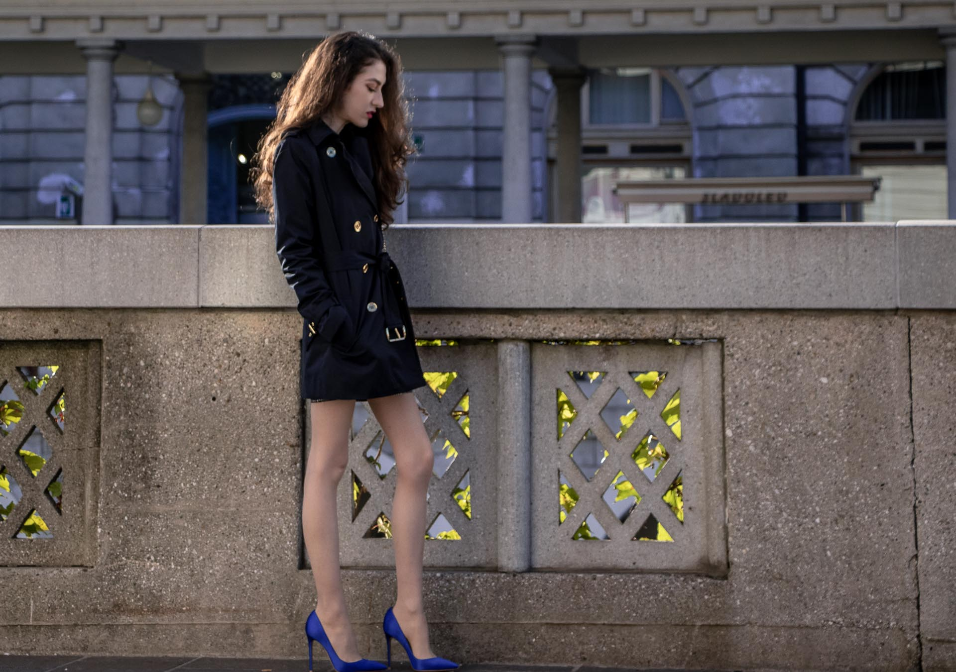 Beautiful Slovenian Fashion Blogger Veronika Lipar of Brunette from Wall wearing dark navy Michael Kors short trench coat, Gianvito Rossi blue satin court shoes, white chain shoulder bag walking home after clubbing