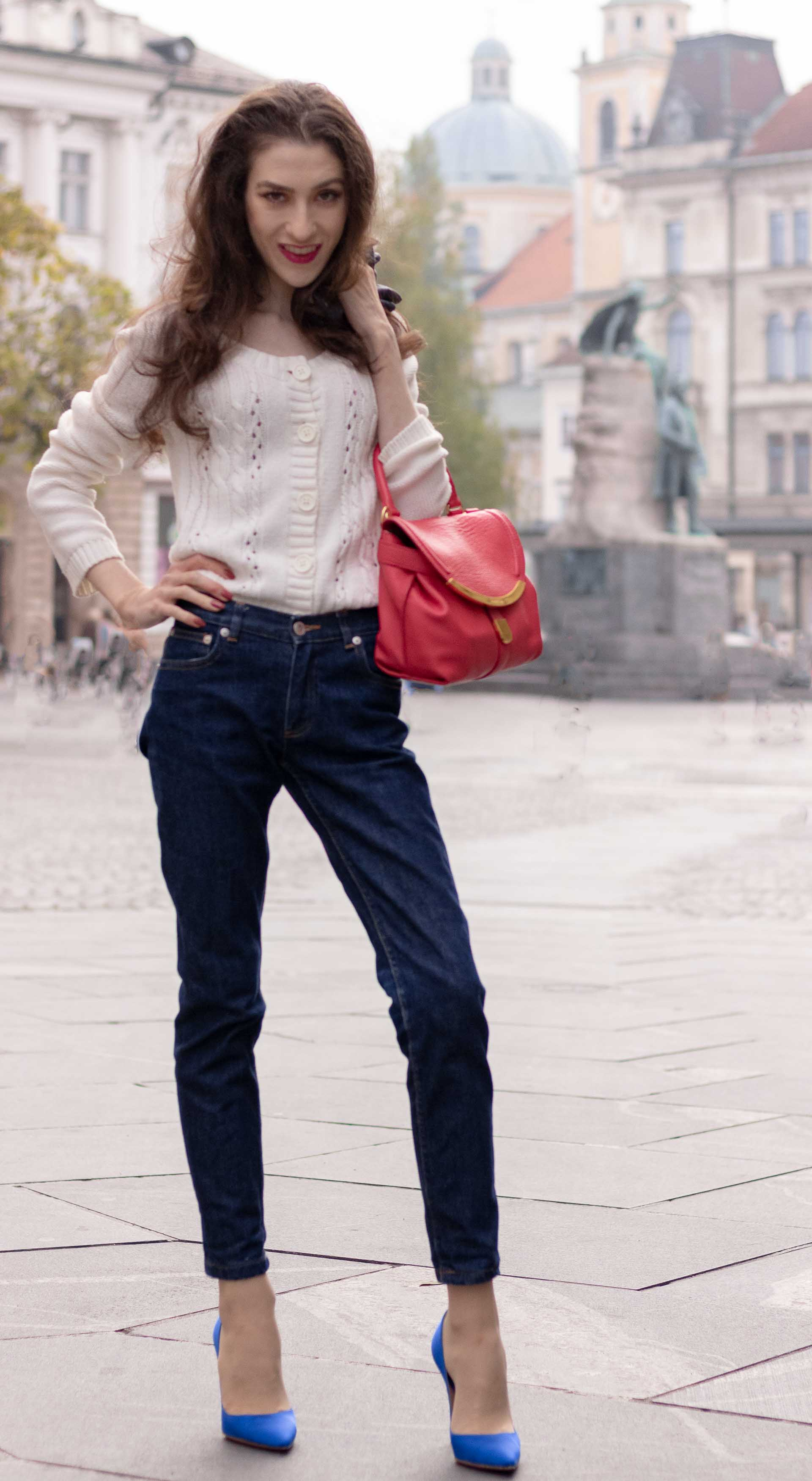 Beautiful Slovenian Fashion Blogger Veronika Lipar of Brunette from Wall dressed in white Mango cardigan tucked into dark blue denim jeans from a.p.c., blue Gianvito Rossi pumps, pink top handle bag on the street