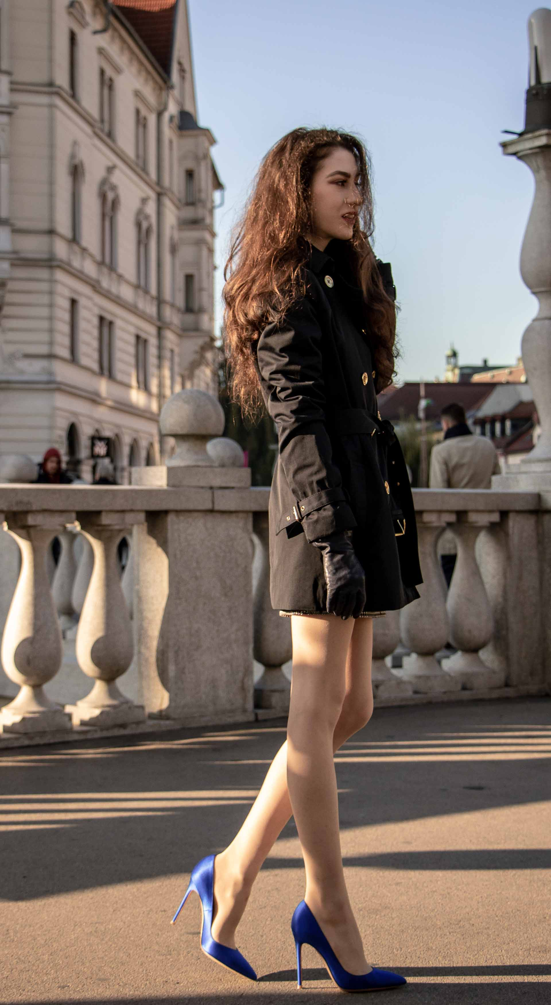 Beautiful Slovenian Fashion Blogger Veronika Lipar of Brunette from Wall wearing dark navy Michael Kors short trench coat, Gianvito Rossi blue satin court shoes, white chain shoulder bag walking home after night out