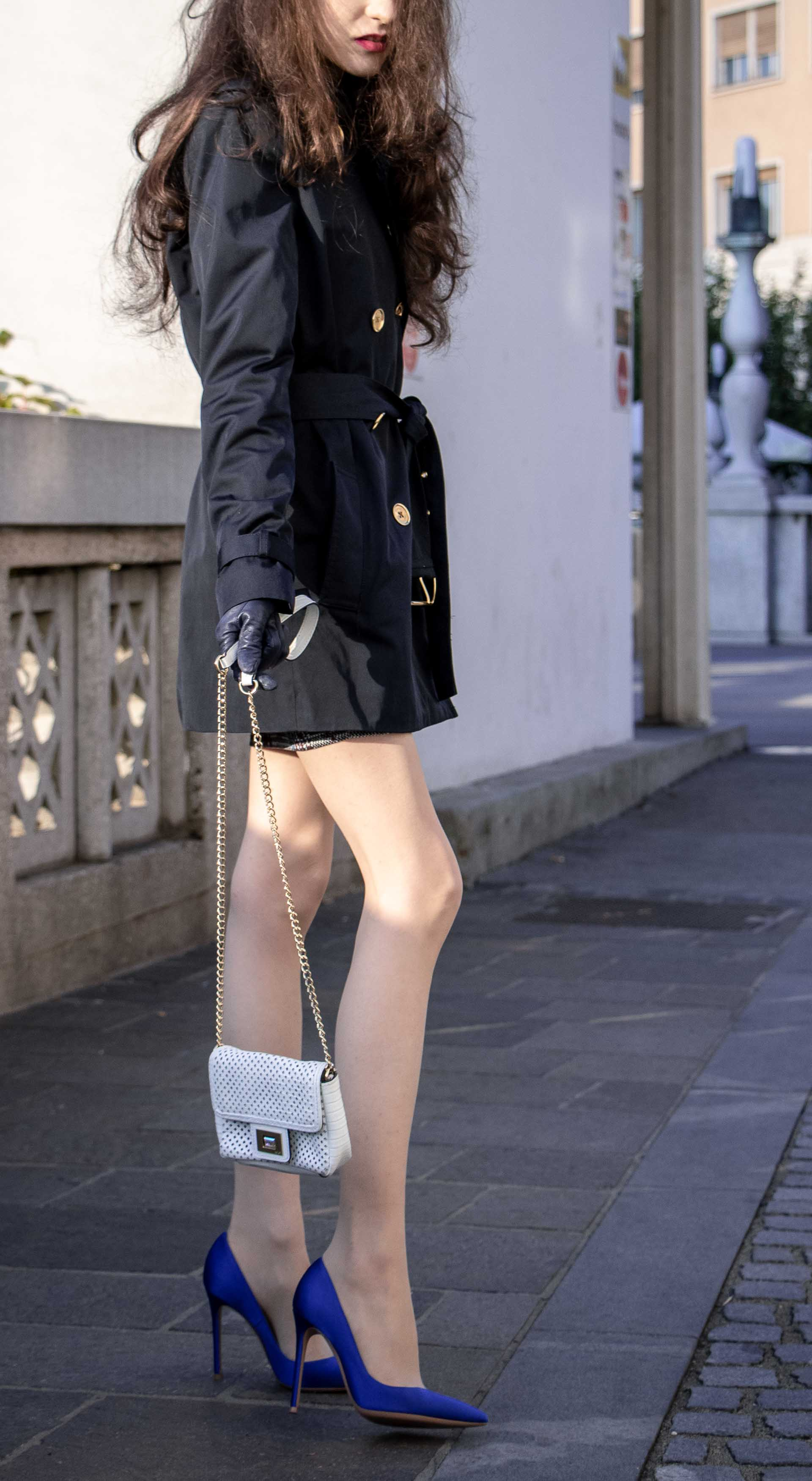 Beautiful Slovenian Fashion Blogger Veronika Lipar of Brunette from Wall wearing dark navy Michael Kors short trench coat, Gianvito Rossi blue satin court shoes, white chain shoulder bag morning after party