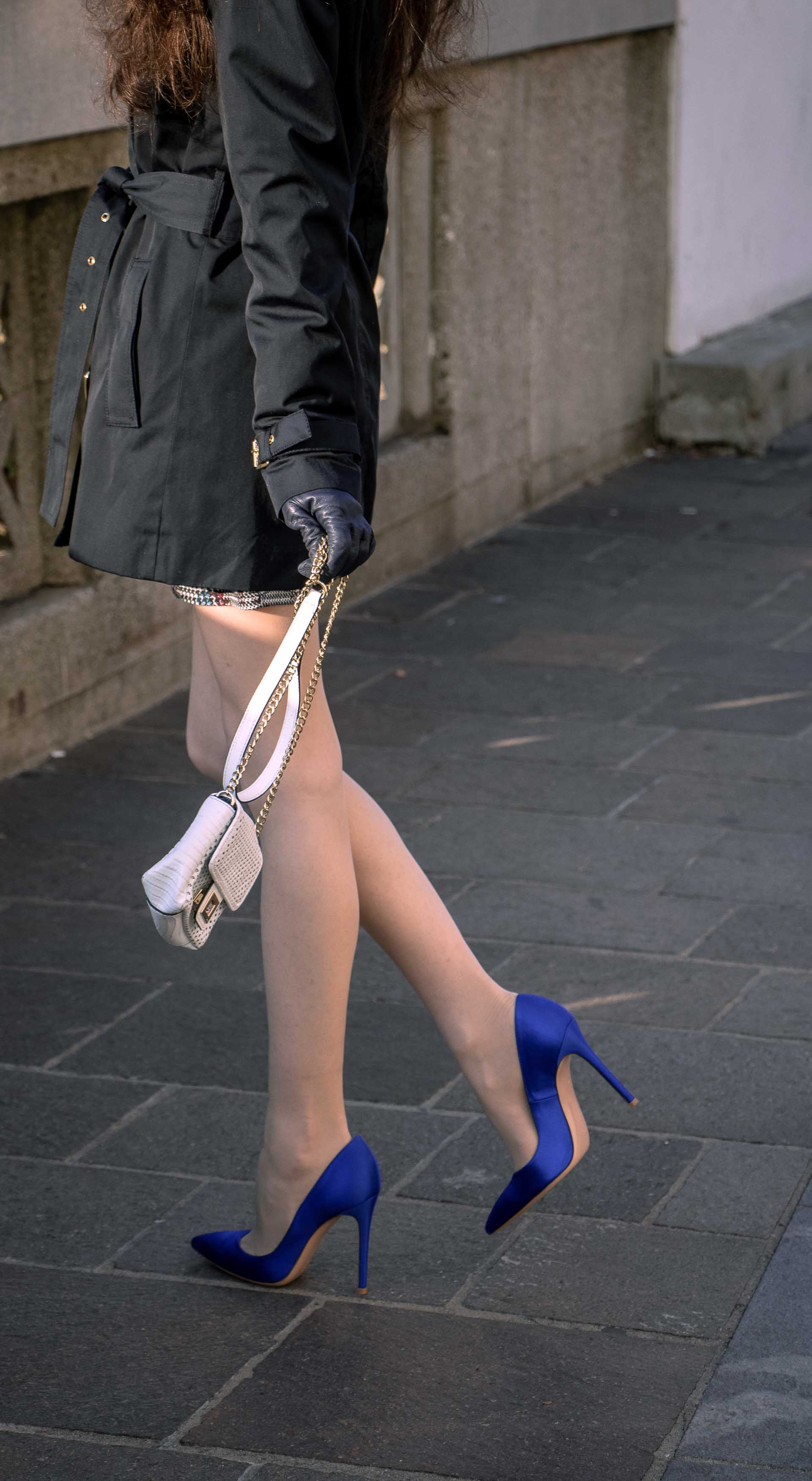 Beautiful Slovenian Fashion Blogger Veronika Lipar of Brunette from Wall dressed in dark navy Michael Kors short trench coat, Gianvito Rossi blue satin court shoes, white chain shoulder bag morning after party