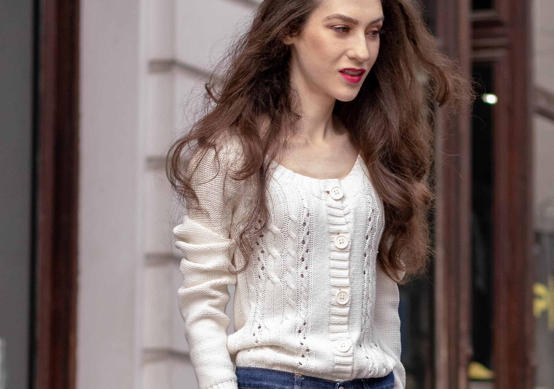 Beautiful Slovenian Fashion Blogger Veronika Lipar of Brunette from Wall wearing white Mango cardigan tucked into dark blue denim jeans from a.p.c.