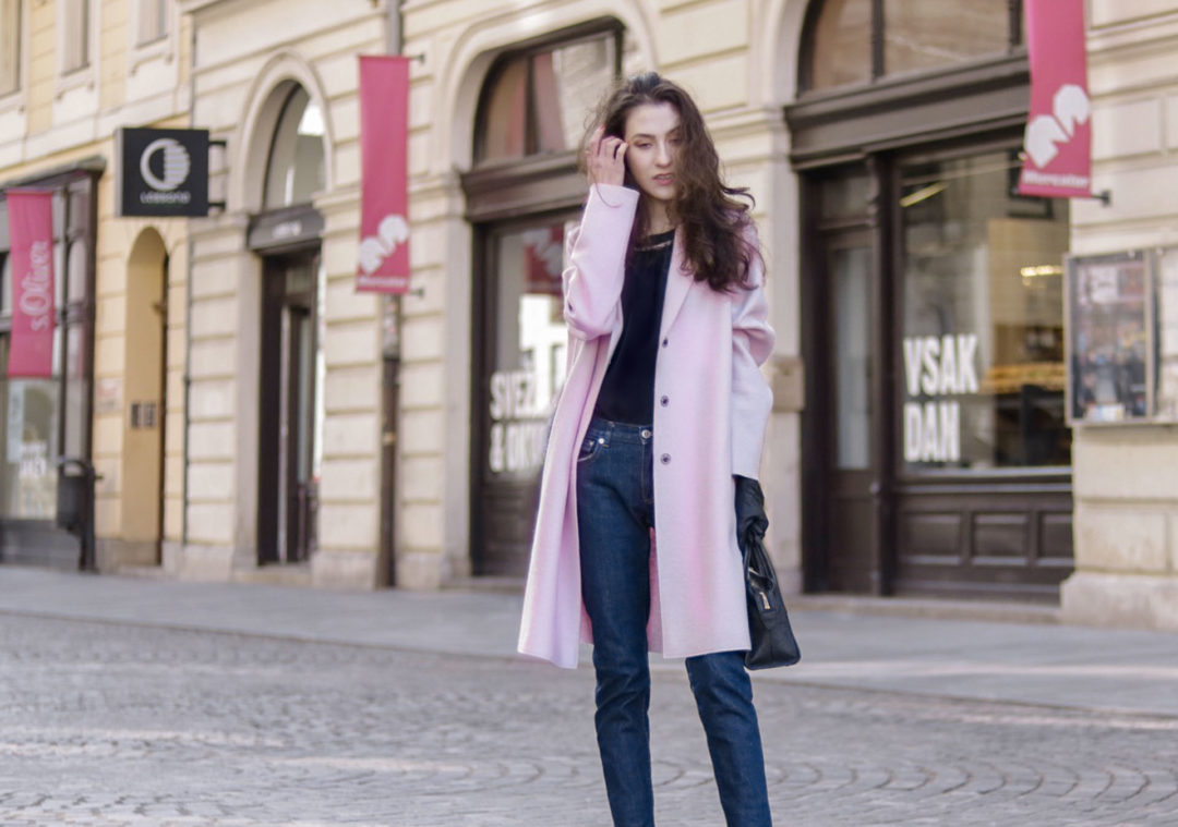 Beautiful Slovenian Fashion Blogger Veronika Lipar of Brunette from Wall dressed in Harris Wharf London pink oversized coat, black silk blouse, dark blue tampered a.p.c. paris jeans, black top handle bag, tucking hair behind the ear on the street