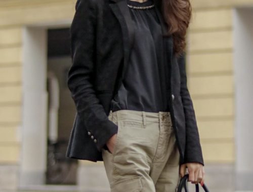 Beautiful Slovenian Fashion Blogger Veronika Lipar of Brunette from Wall wearing black jacquard blazer, black silk blouse, black top handle bag, Closed khaki cargo pants on the street in Ljubljana