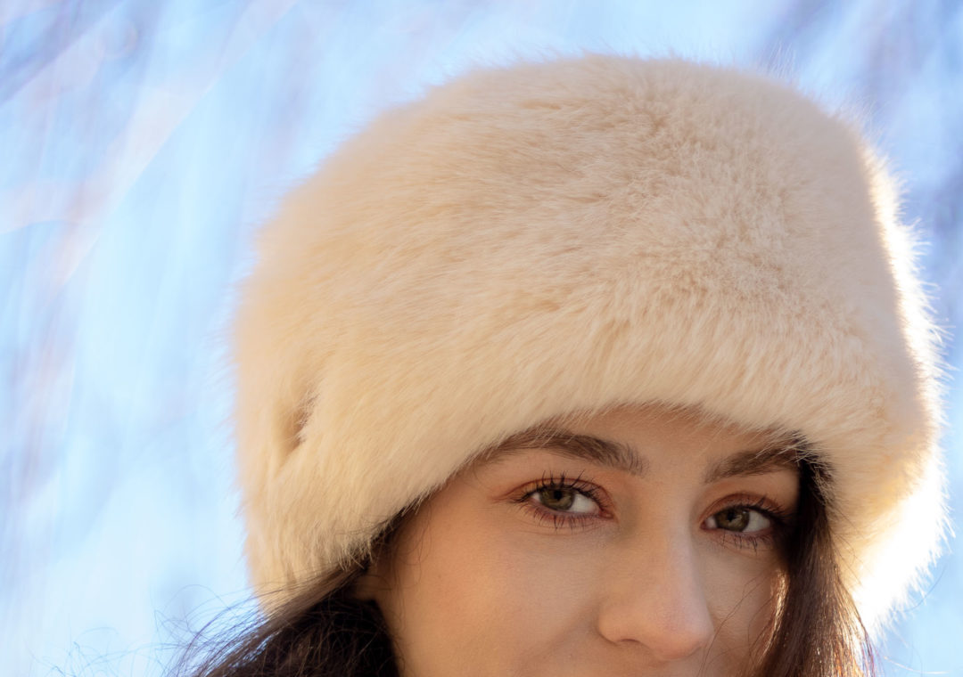 Must follow fashion blogger Veronika Lipar of Brunette from Wall Street wearing white faux-fur hat, Benefit brow, Dior mascara, Giorgio Armani foundation in winter