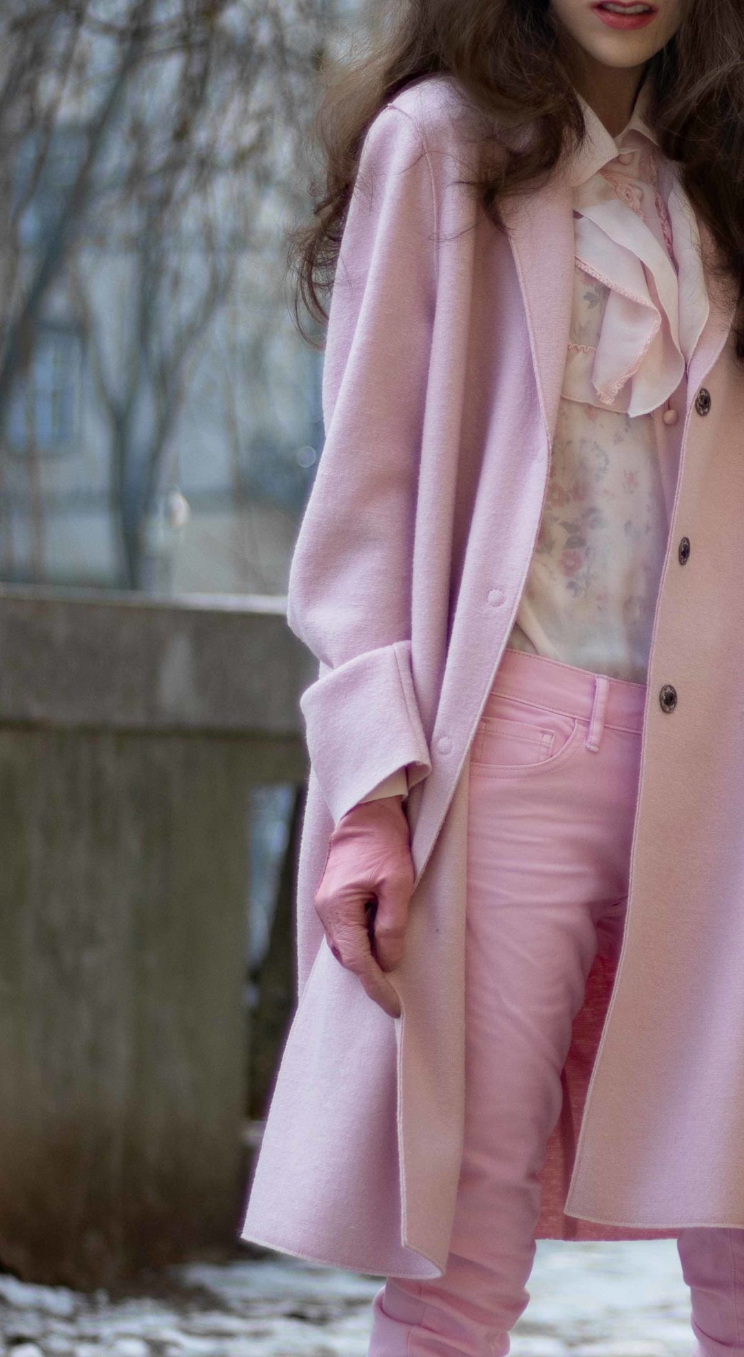 Slovenian Fashion blogger to follow Veronika Lipar of Brunette from Wall Street wearing pink skinny jeans, Red Valentino pink ruffled blouse, Harris Wharf London pink overcoat, Forzieri pink leather gloves in winter