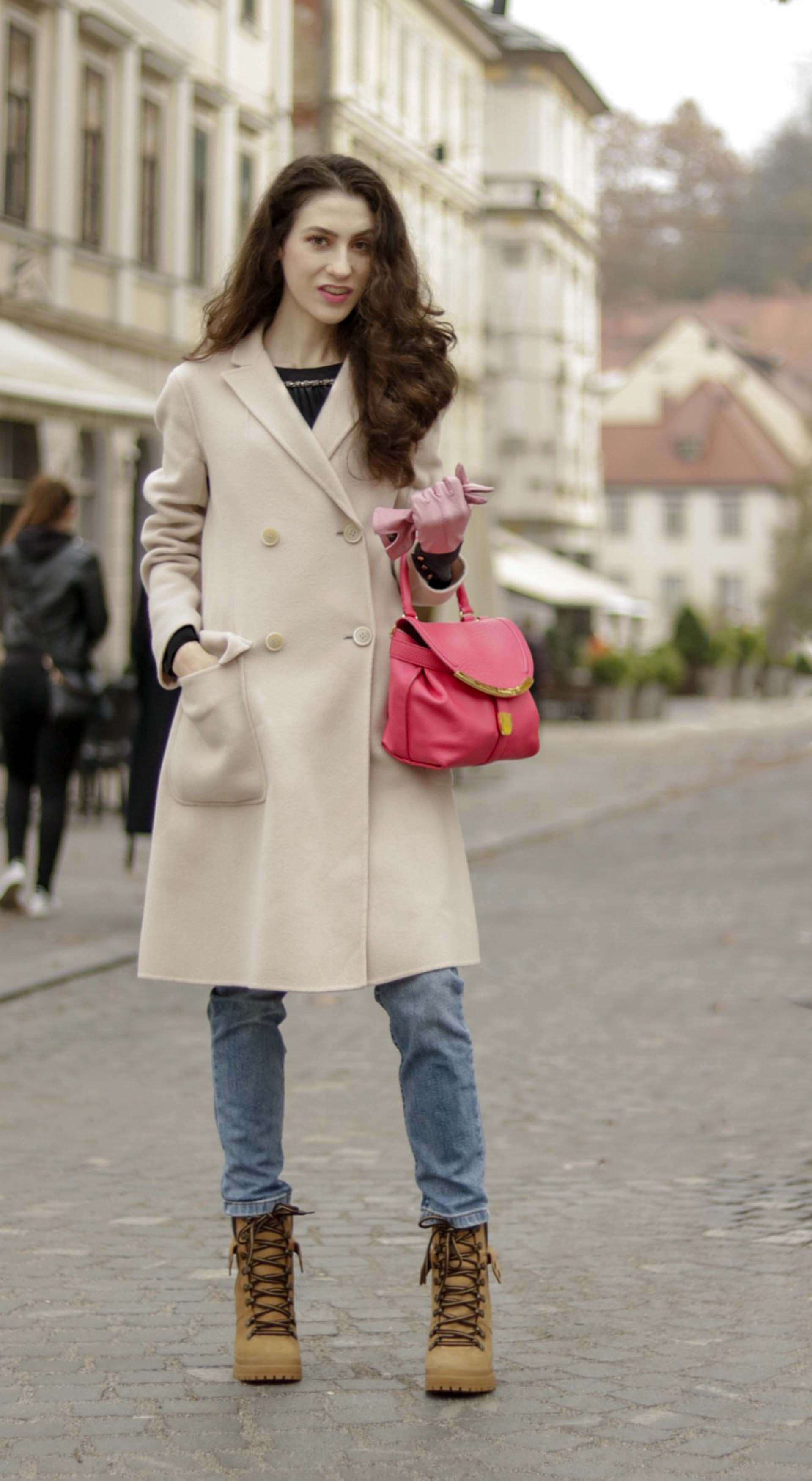Must follow Slovenian Fashion Blogger Veronika Lipar of Brunette from Wall Street dressed in See By Chloé hiking boots with heels, A.P.C. light blue straight leg denim jeans, Max Mara double-breasted coat, See By Chloé pink top handle bag, black blouse, pink leather gloves in winter