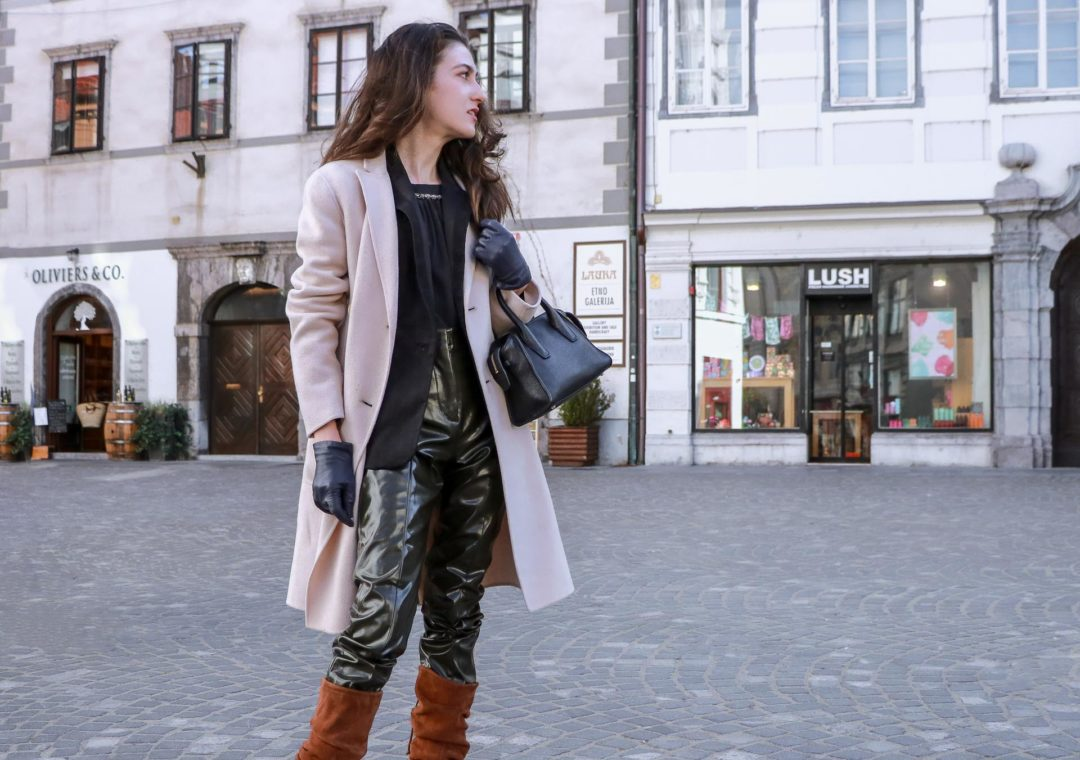 Must follow fashion blogger Veronika Lipar of Brunette from Wall Street wearing Acne Studios vinyl pants, black jacquard blazer, Stuart Weitzman slouchy boots, gloves, Weekend Max Mara double breasted coat, black top handle bag on the street