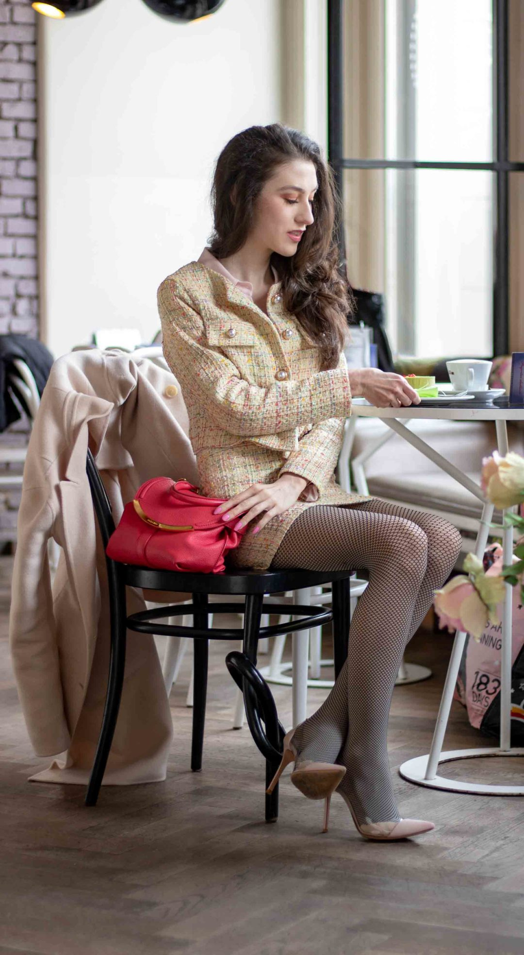 Must follow fashion blogger Veronika Lipar of Brunette from Wall Street dressed in yellow tweed skirt suit, fishnets, Gianvito Rossi plexiglass pumps at Lolita patisserie