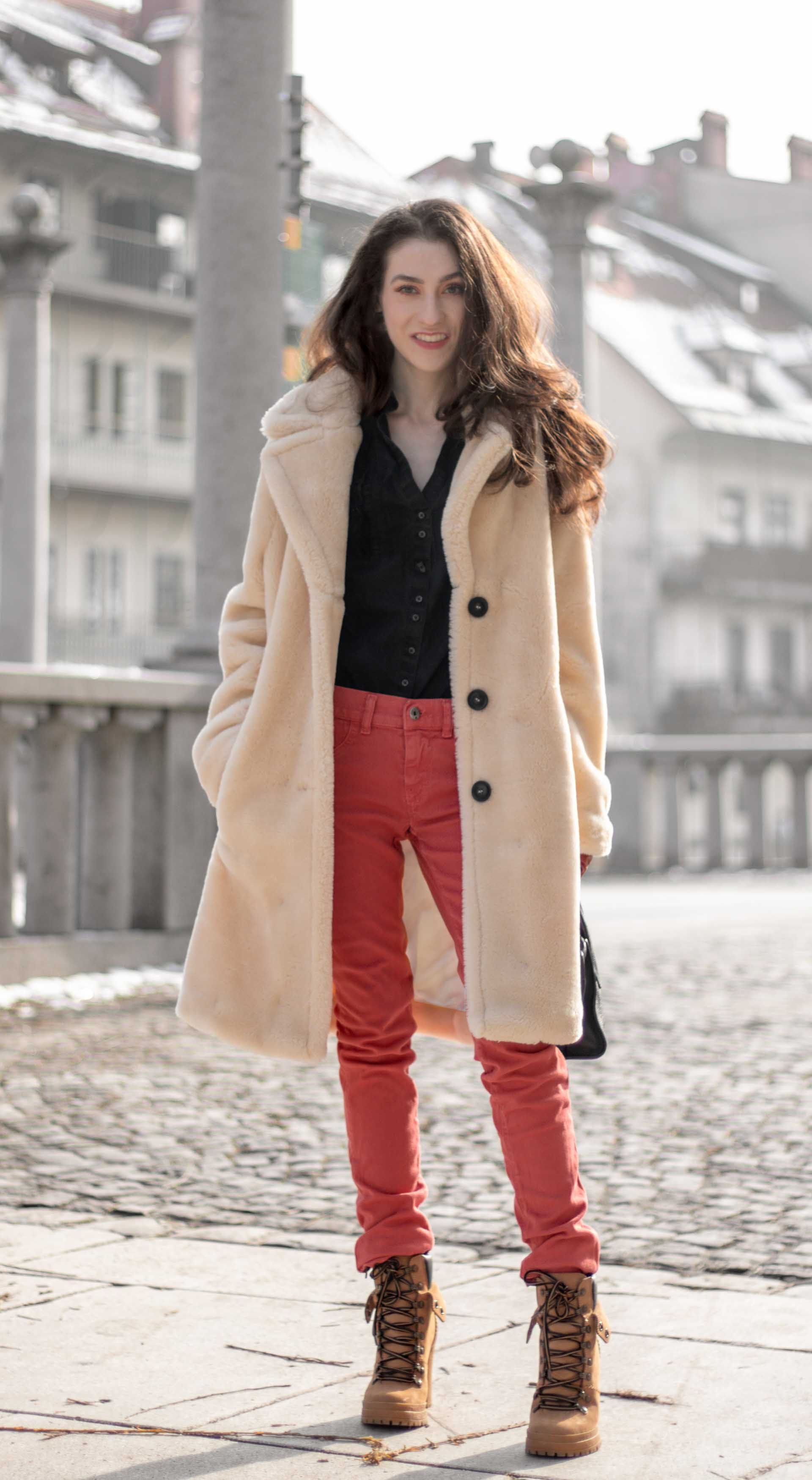 e5dc221e60 Must follow fashion blogger Veronika Lipar of Brunette from Wall Street wearing  red skinny jeans