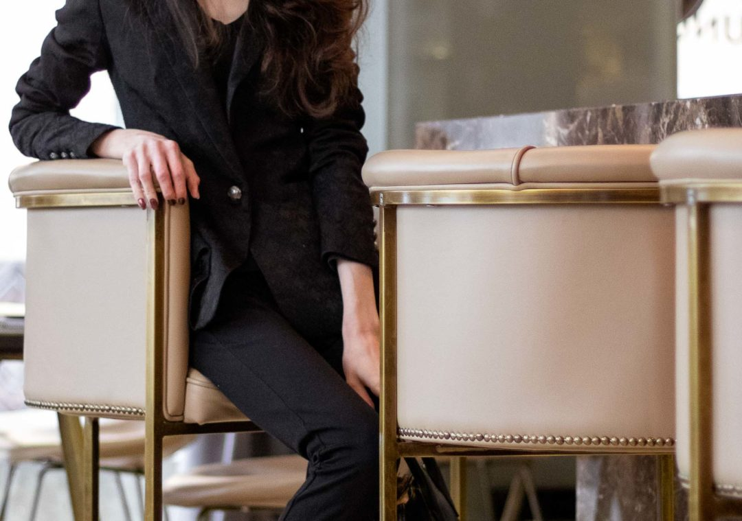 Must follow Fashion Blogger Veronika Lipar of Brunette from Wall Street wearing black pantsuit for Valentine's date