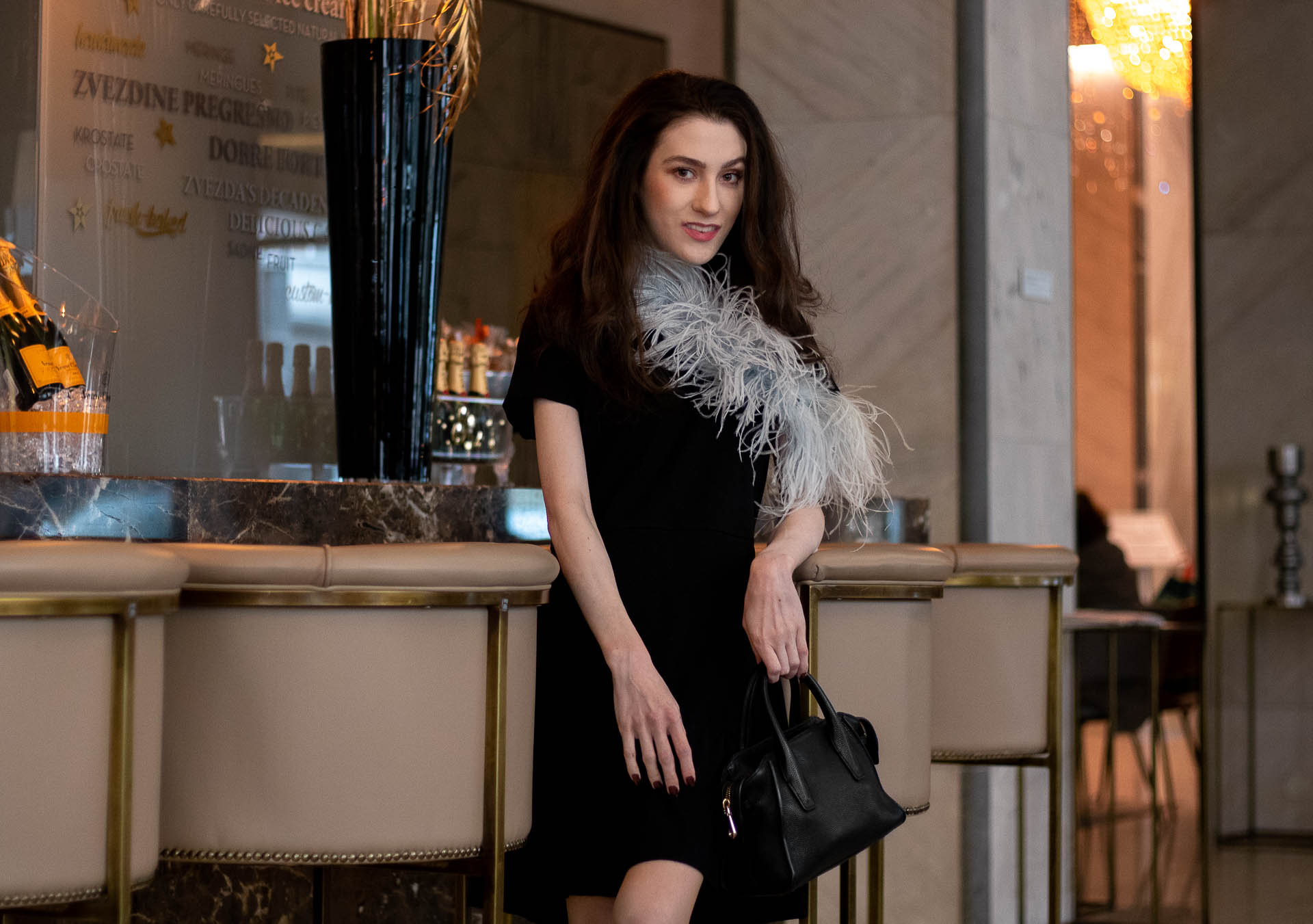 afabe643ee285 ... Popular Fashion Blogger Veronika Lipar of Brunette from Wall Street  wearing short sleeve LBD with feathers